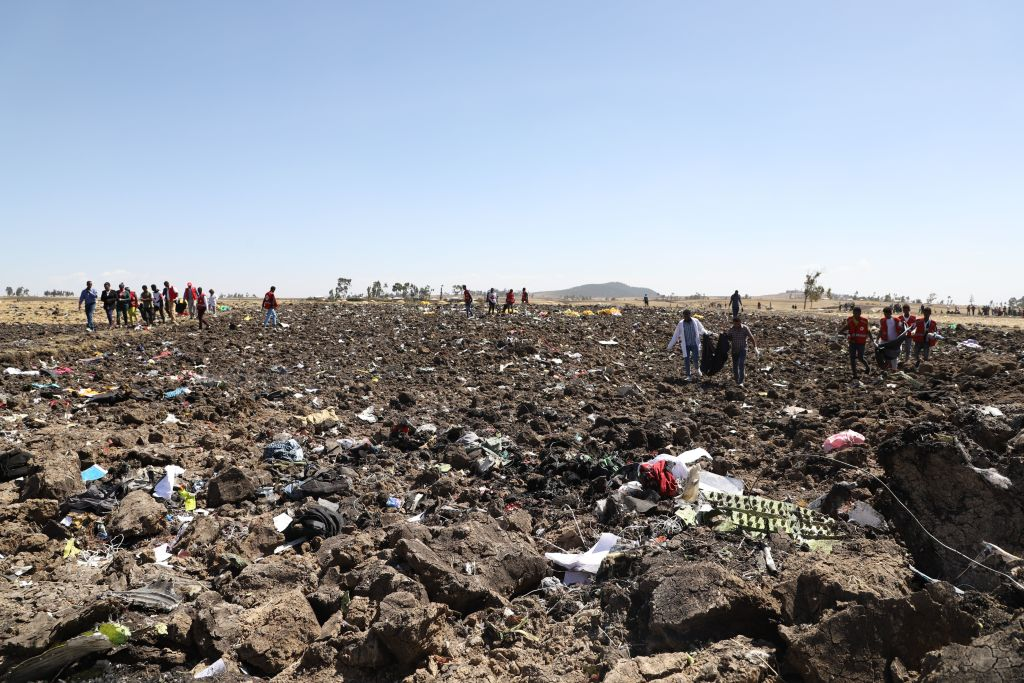 Rescue teams collect bodies amid debris at the crash site of Ethiopian Airlines Flight 302 on March 10, 2019.
