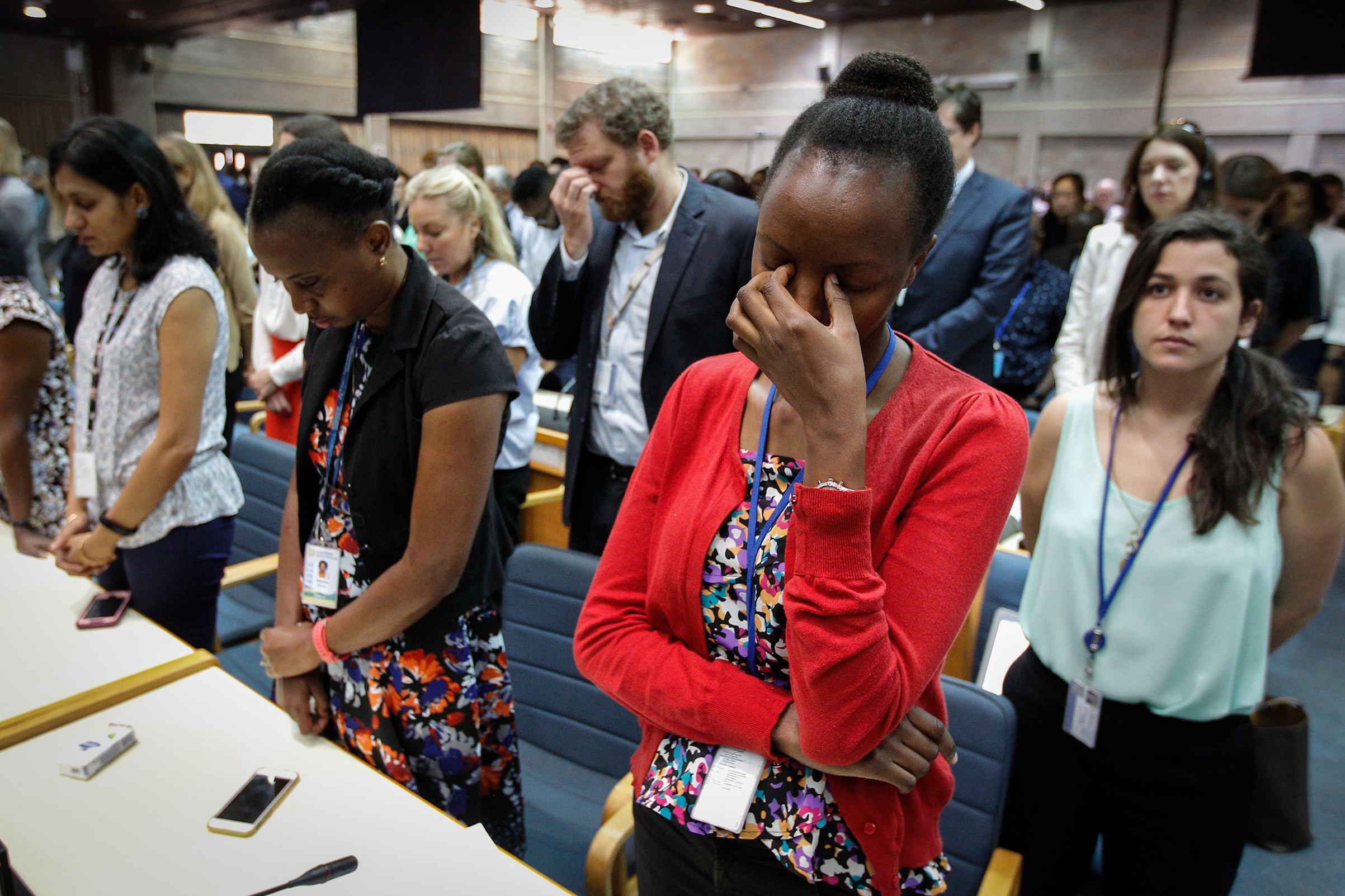 U.N. staff members observe a minute of silence for the victims of the Ethiopian Airlines crash, at the UN headquarters in Nairobi, Kenya, on March 11, 2019.