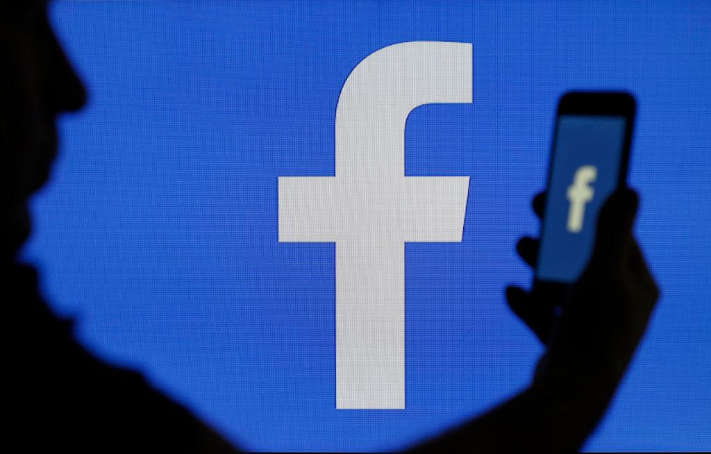 The Facebook logo is seen on a Facebook is displayed on the screen of a computer on March 15, 2019 in Paris, France.