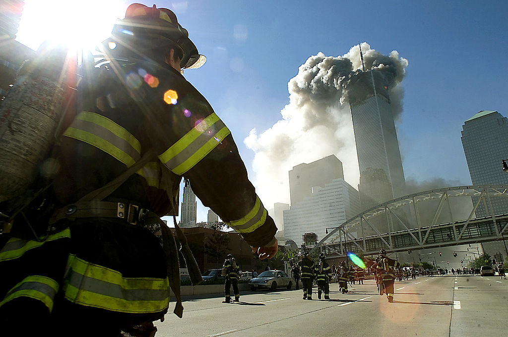 Firefighters walk towards one of the World Trade Center towers before it collapsed after a plane hit the building Sept. 11, 2001 in New York City.