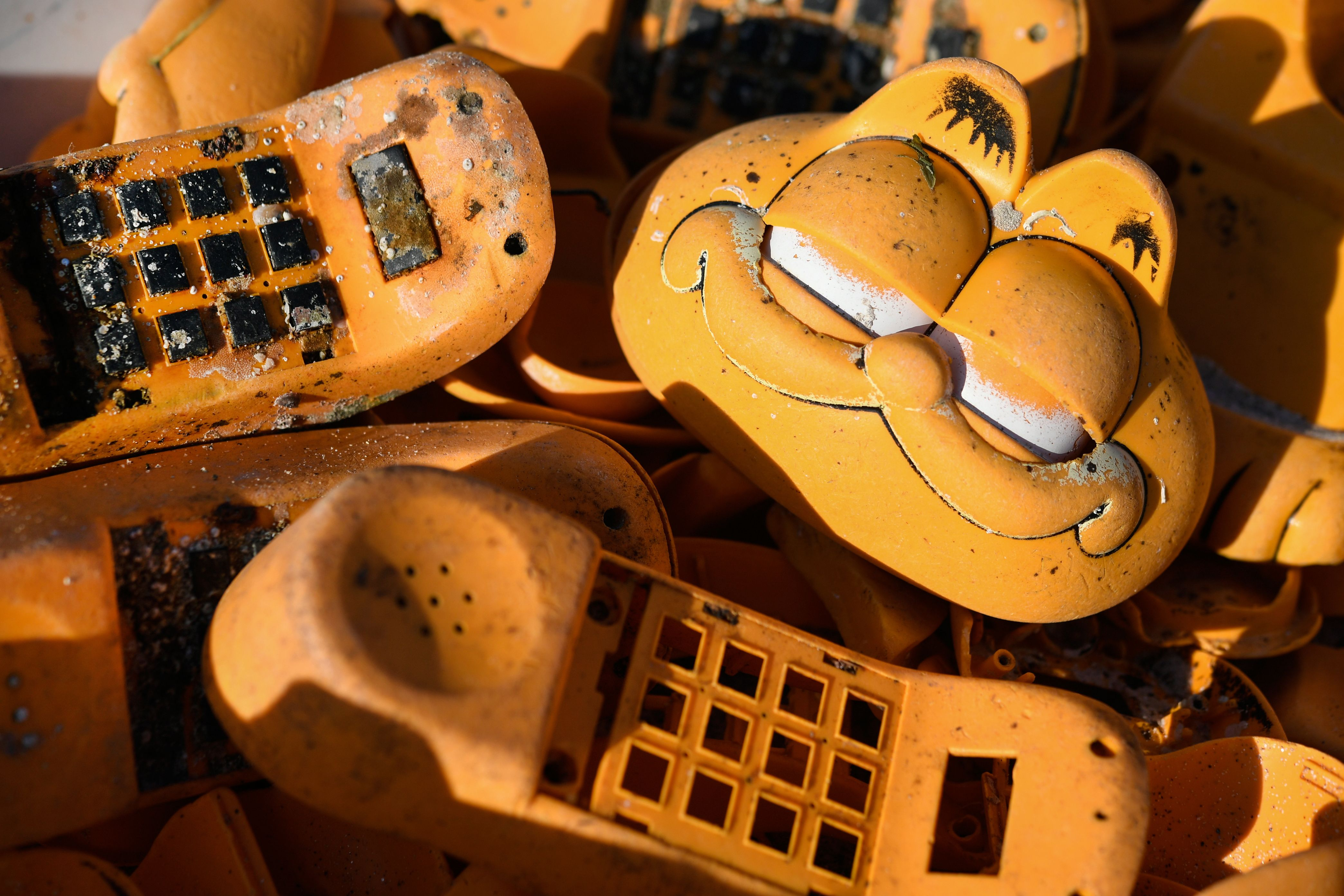 'Garfield' phones are displayed on the beach on March 28, 2019 in Plouarzel, western France. (Photo by Fred TANNEAU / AFP) (Photo credit should read FRED TANNEAU/AFP/Getty Images)