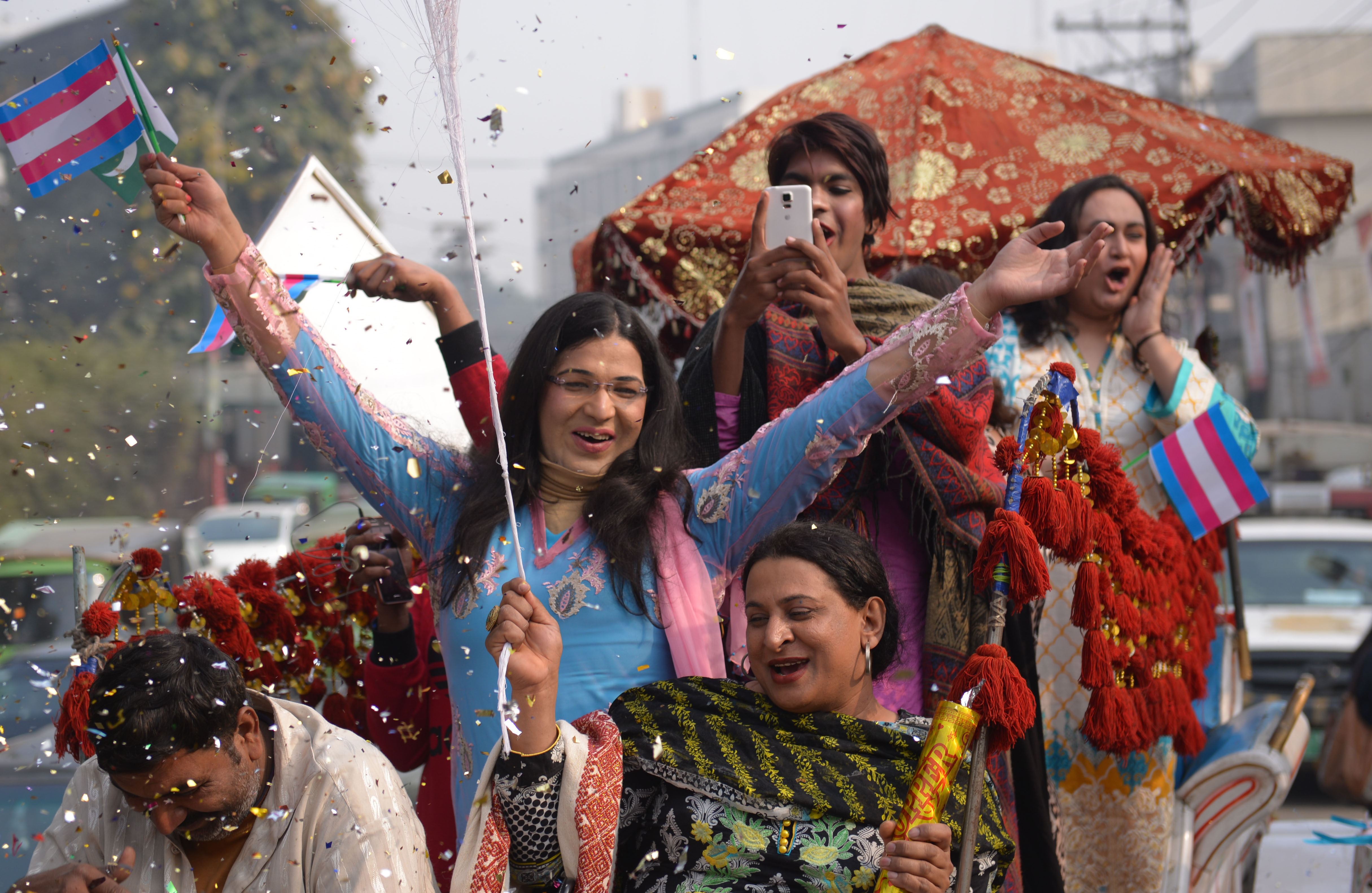 Members of the Pakistani transgender community parade during a rally to demand for the implementation of the transgender rights bill in Lahore on December 29, 2018.