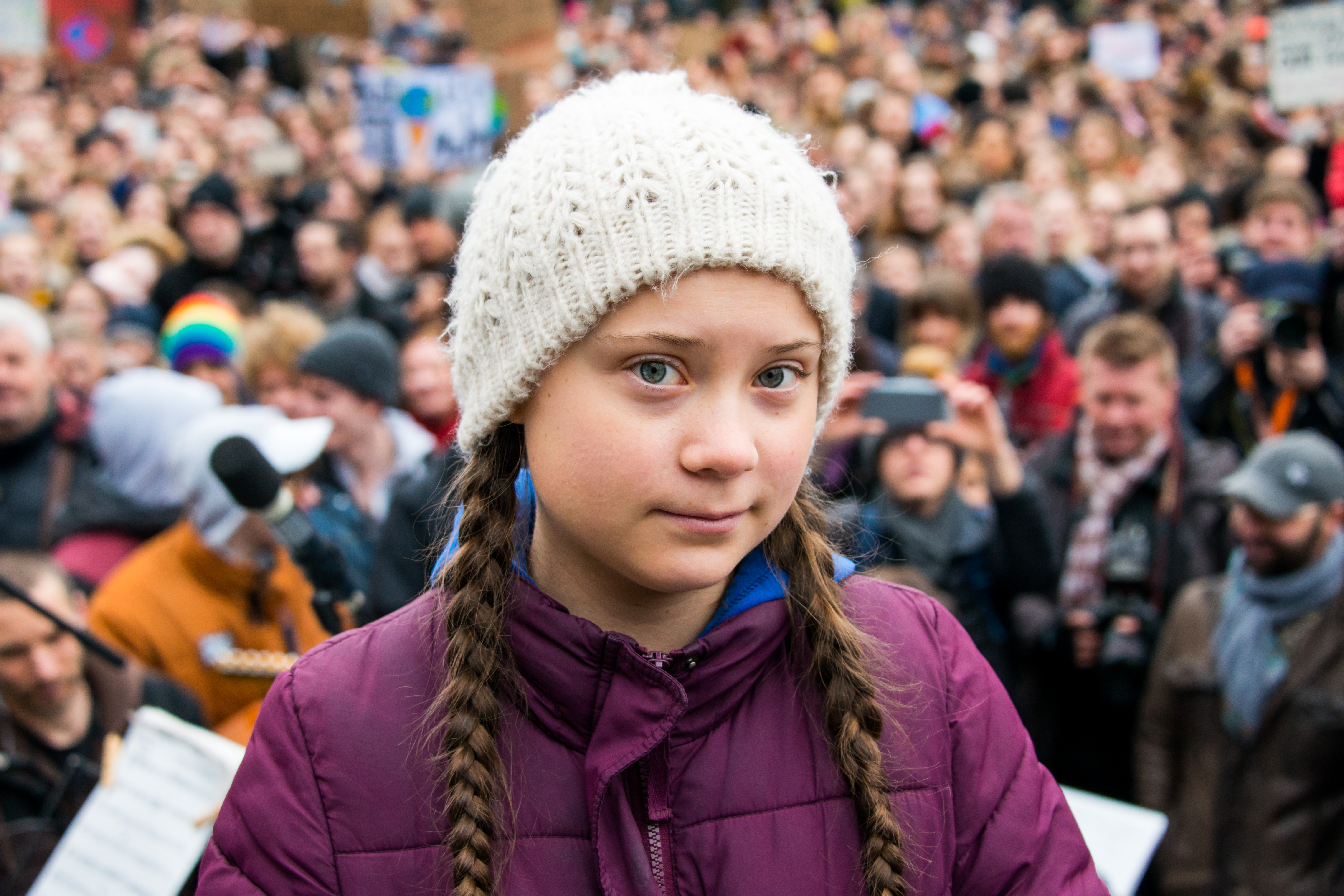 Greta Thunberg, climate activist, stands on a stage during a rally at the town hall market in Hamburg, Germany, on Mar. 1, 2019.