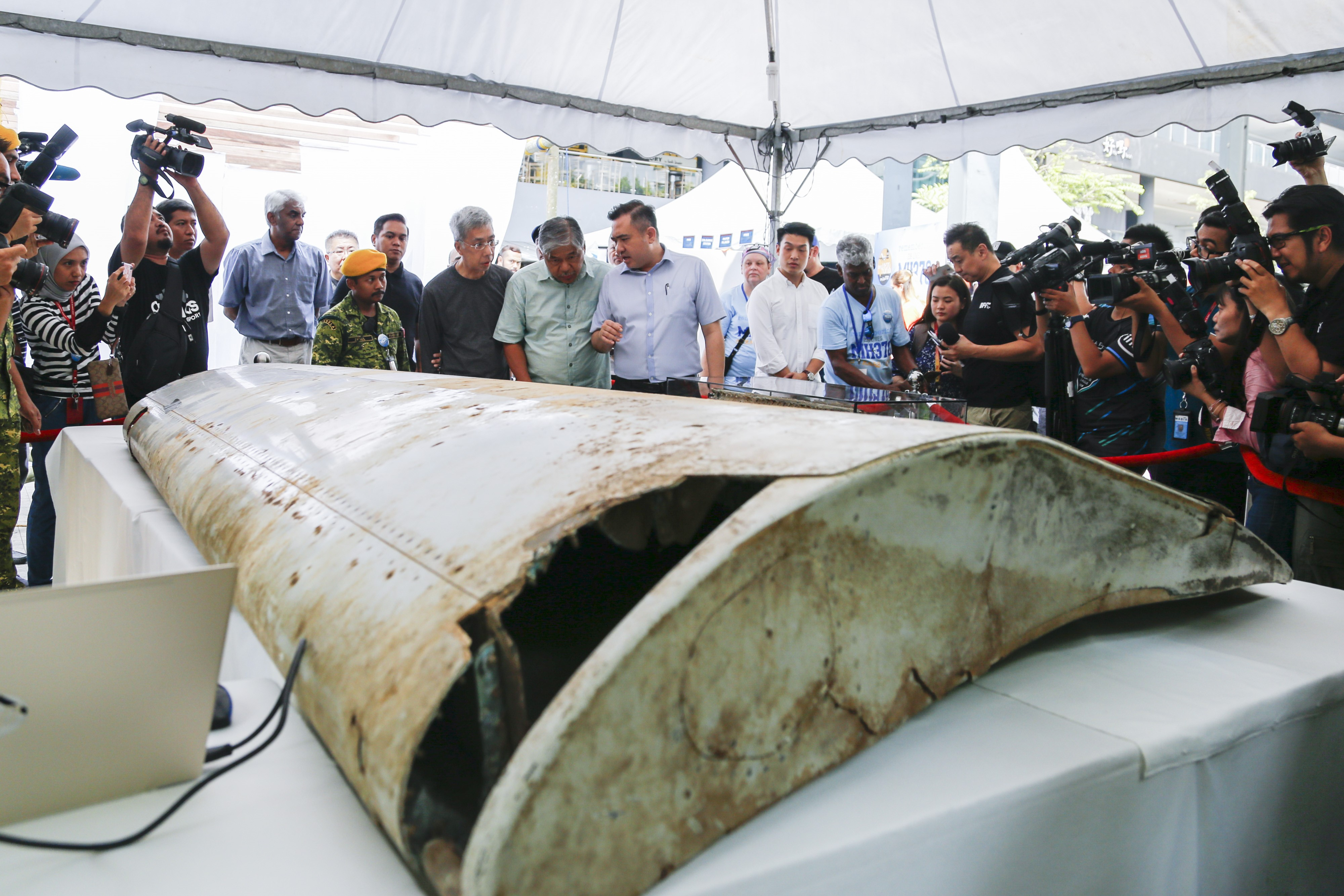 Malaysian Minister of Transport Anthony Loke looks at a wing flap that was identified as part of the missing Malaysia Airlines Flight MH370, displayed in Kuala Lumpur, Malaysia on March 3, 2019.