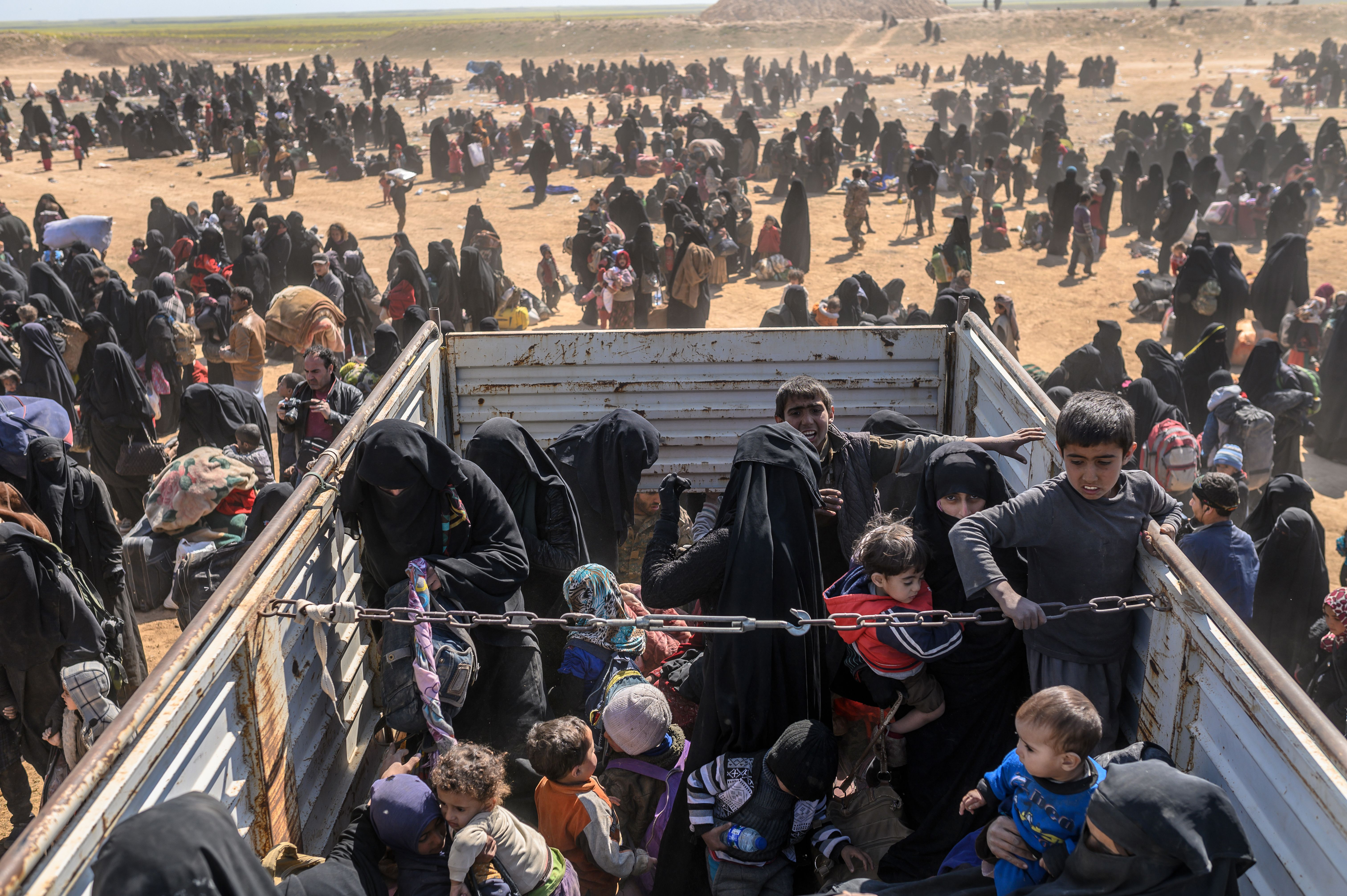 Civilians evacuated from Baghouz wait at a screening area in the eastern Syrian province of Deir Ezzor on March 6, 2019.