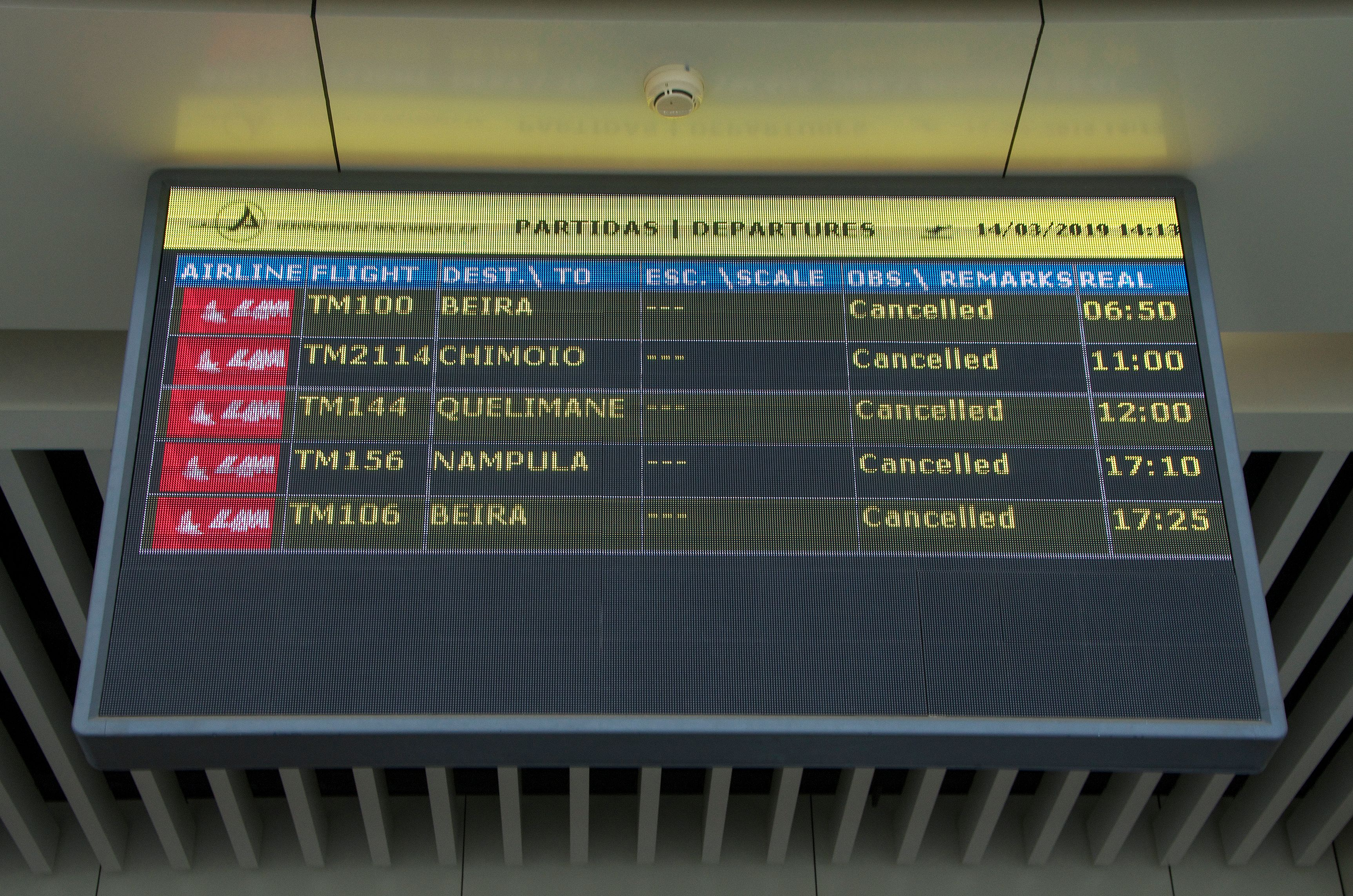 A electronic panel indicating that all departure flights are cancelled is seen at the Maputo International Airport in Mozambique on March 14, 2019.