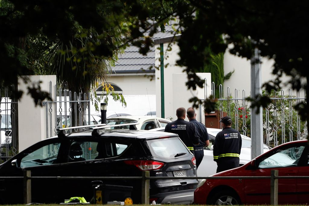 Security officials walk outside the Masjid al Noor mosque after a shooting incident in Christchurch on March 15, 2019.