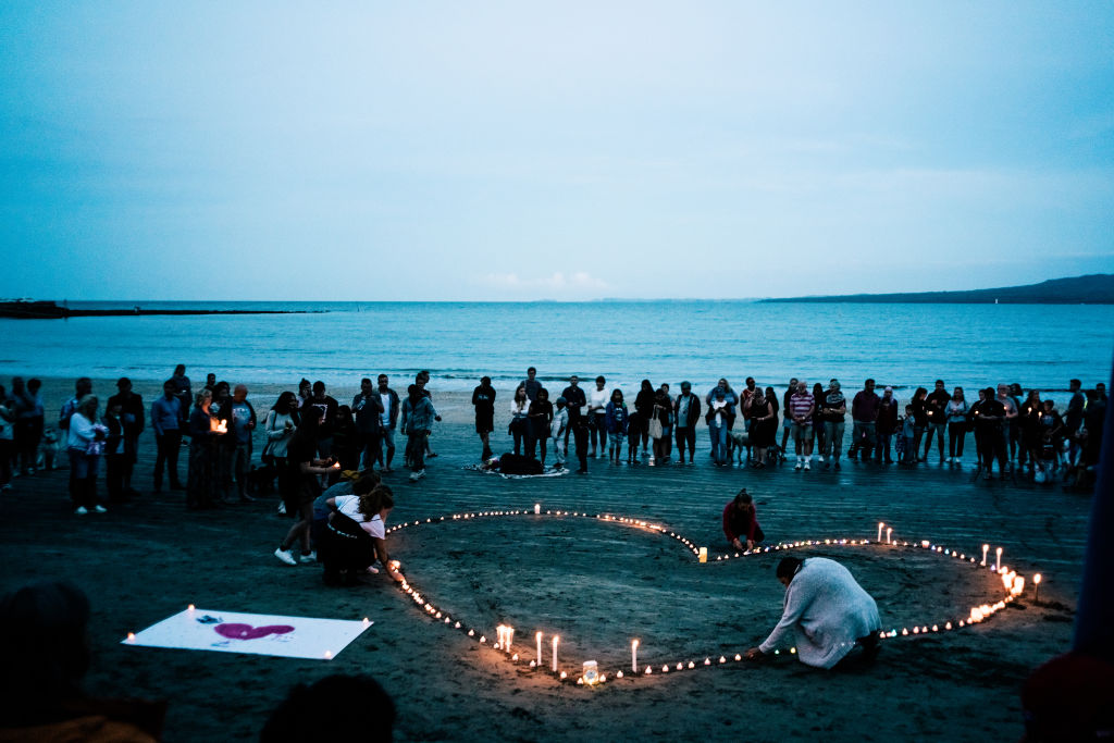 Crowds gather on Takapuna beach for a vigil in memory of the victims of the Christchurch mosque terror attacks on March 16, 2019 in Auckland, New Zealand.