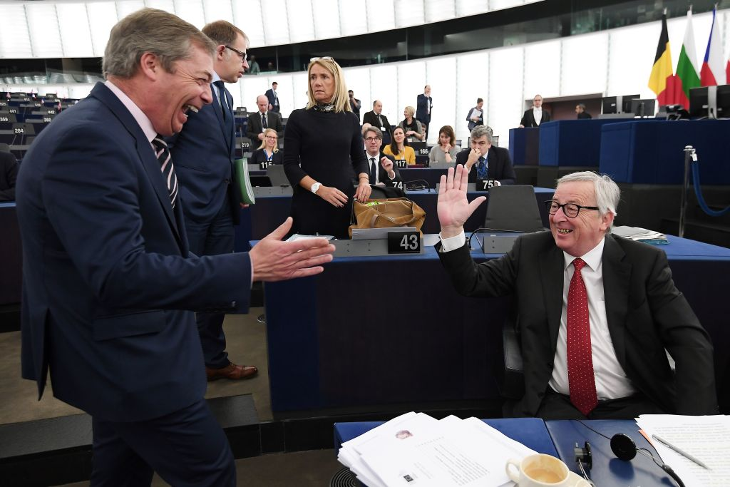 Former UK Independence Party (UKIP) leader, Brexit campaigner and member of the European Parliament Nigel Farage (L) speaks with European Commission President Jean-Claude Juncker at the European Parliament on March 27, 2019 in Strasbourg, eastern France.