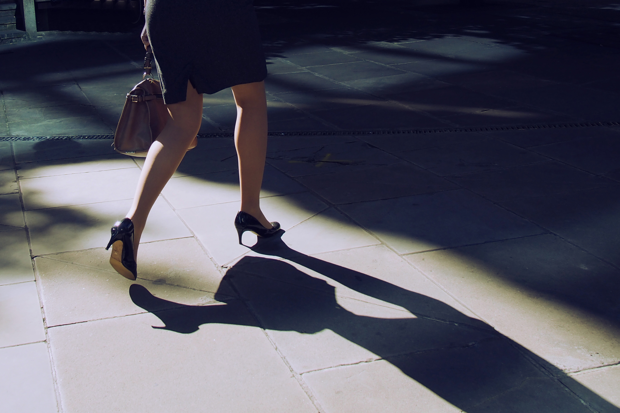 A businesswoman wearing high heels.
