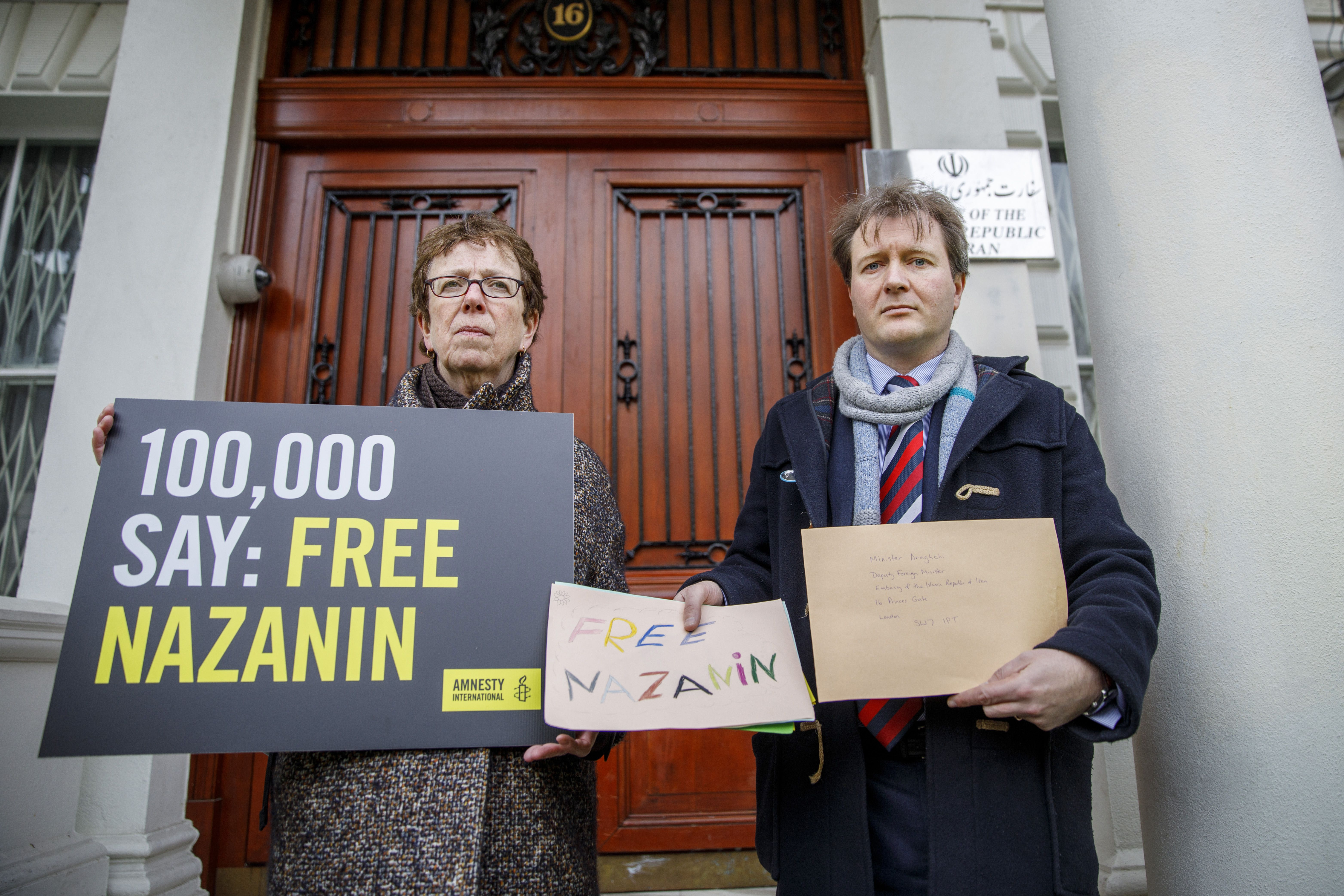 Richard Ratcliffe, (R), husband of jailed British-Iranian woman Nazanin Zaghari-Ratcliffe, delivers a petition and a letter to demand her release, at the Iranian Embassy in London on Feb. 21, 2018.
