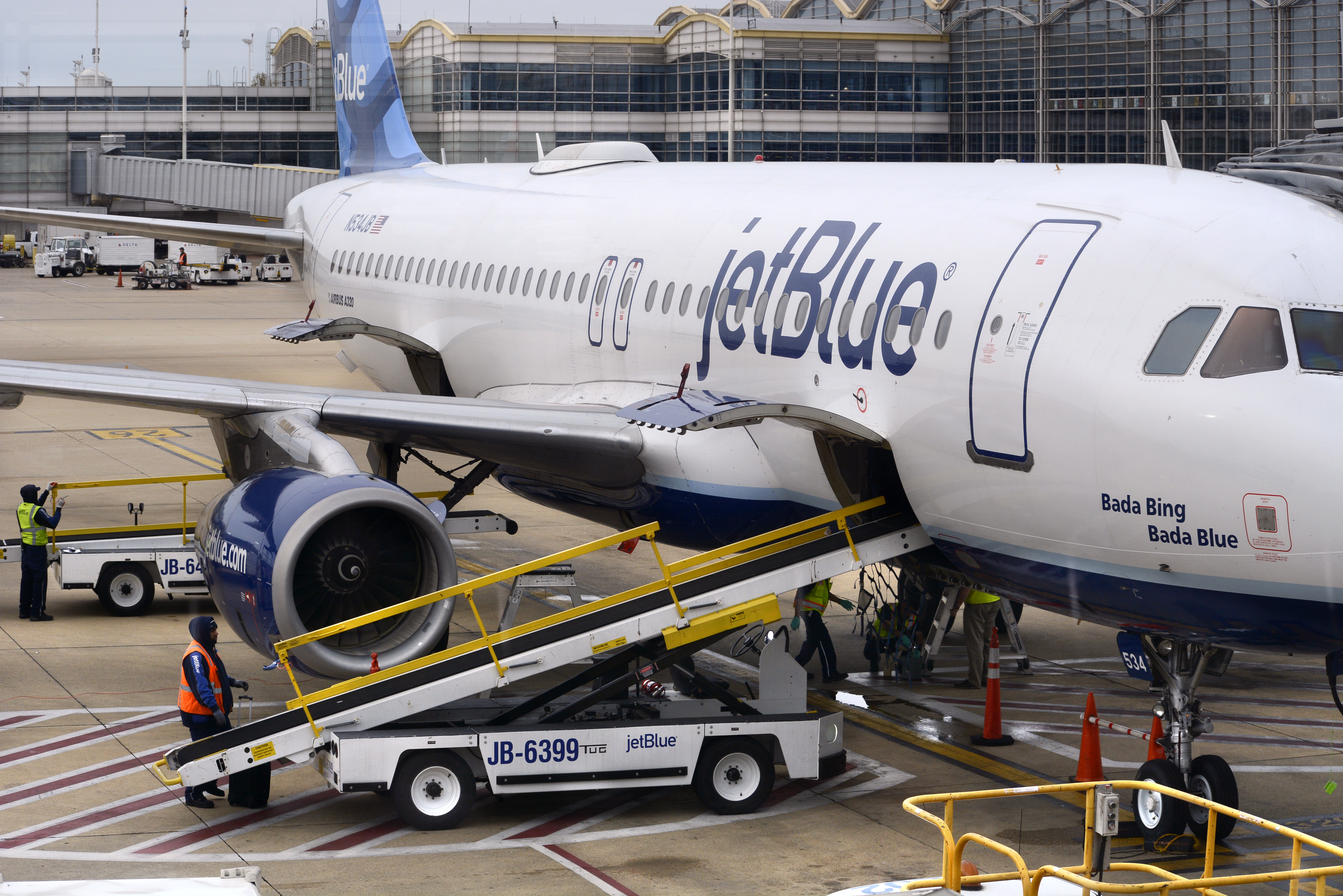 A JetBlue jet is serviced at a gate at the Ronald Reagan Washington National Airport in Washington, D.C. on April 24, 2018.