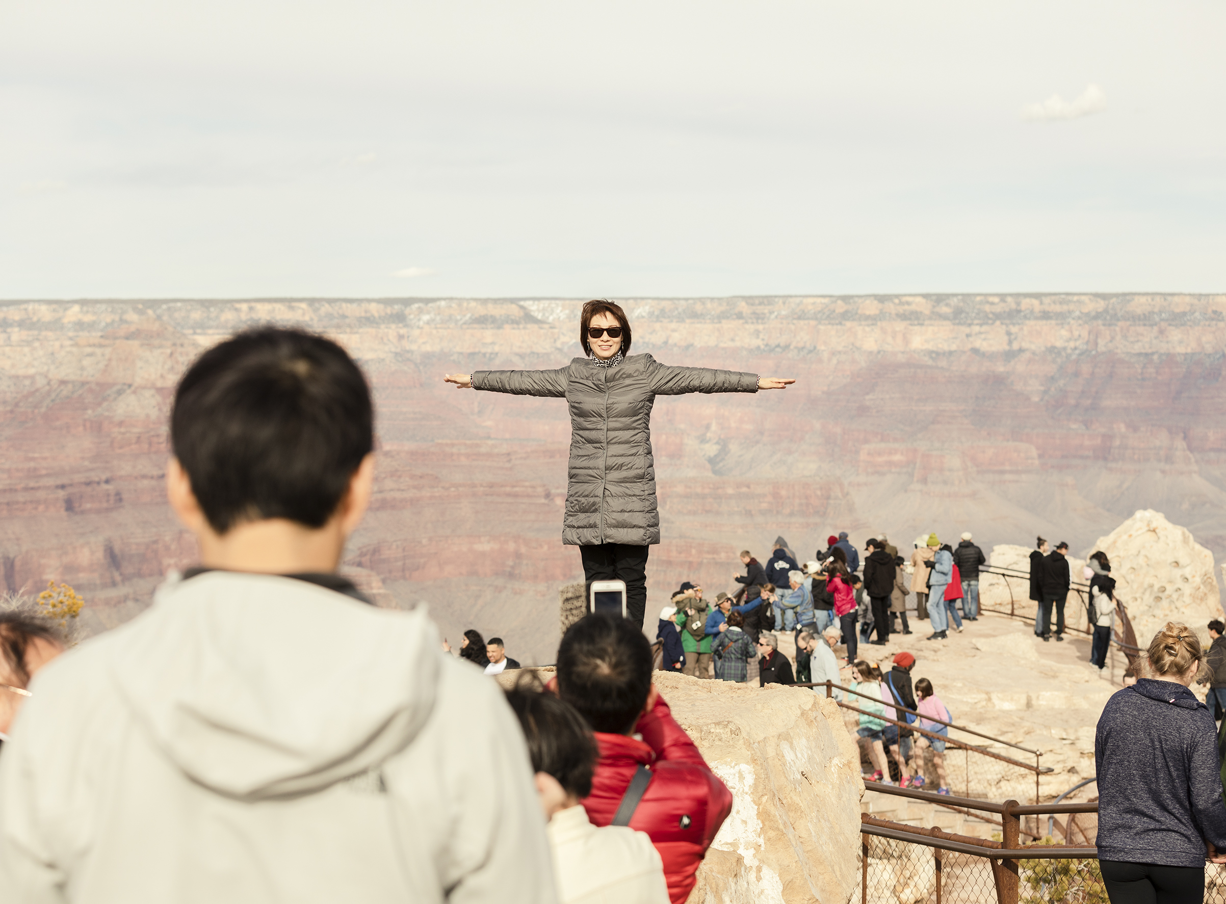 A visitor poses for a photo at Grand Canyon National Park on March 1