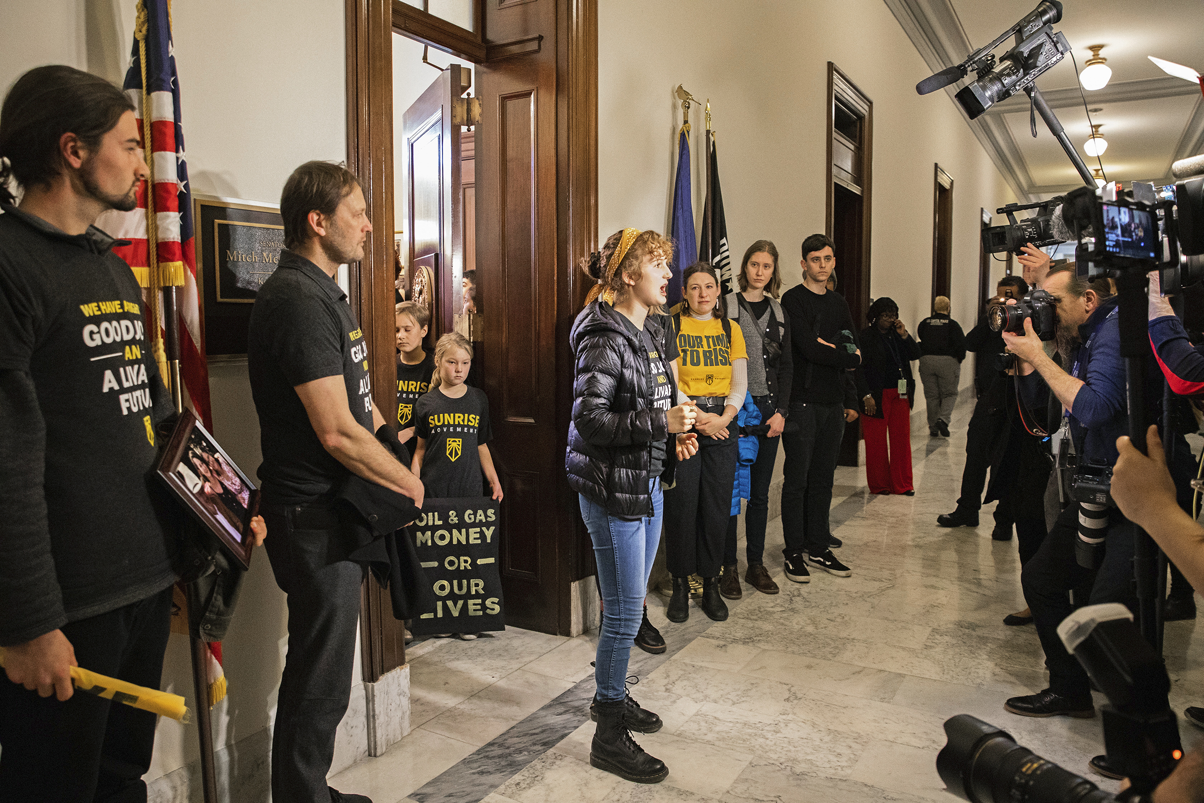 Sunrise Movement activists call for a Green New Deal on Capitol Hill