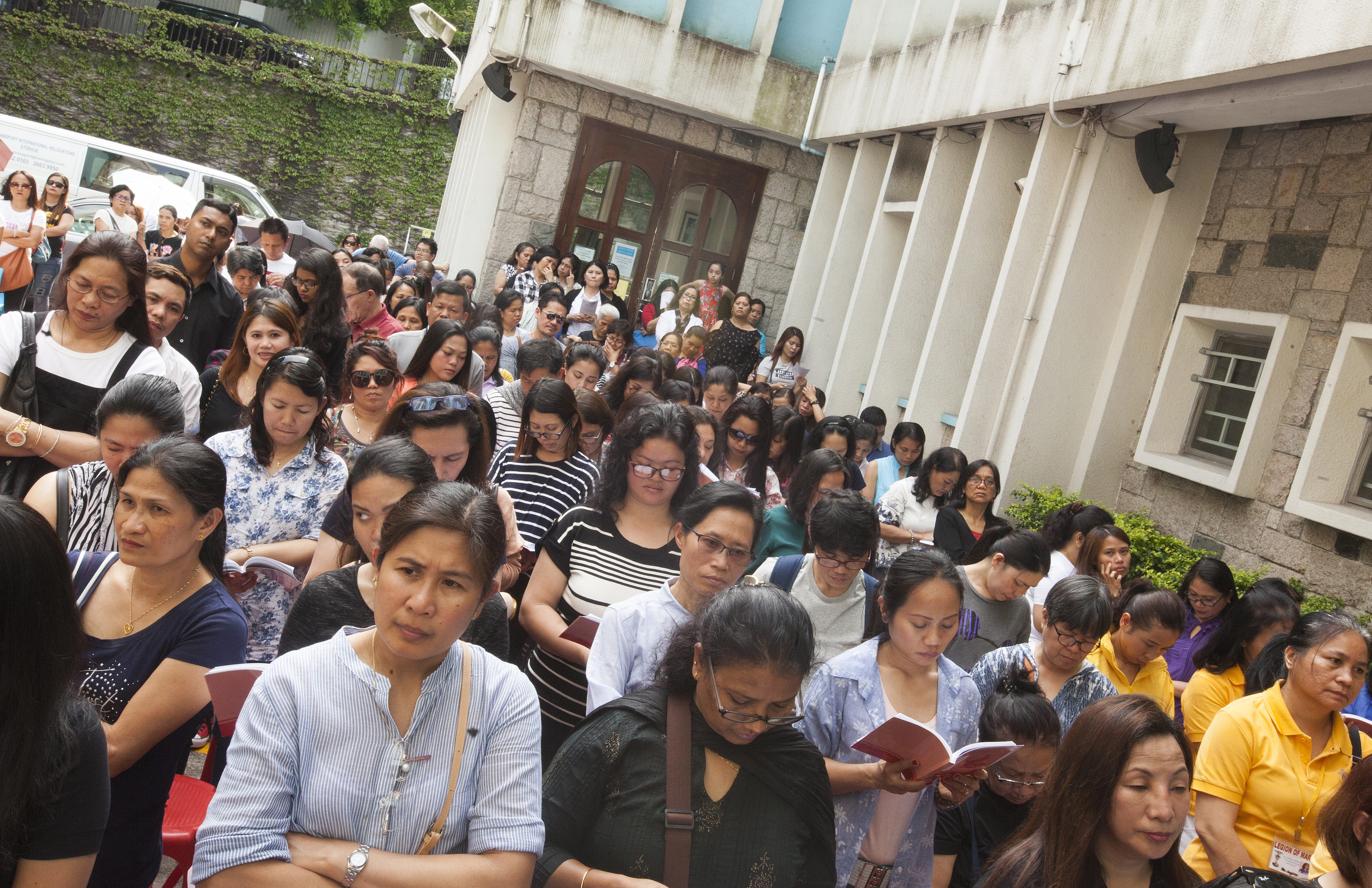 Filipino domestic helpers attend a Good Friday mass at St Joseph's Church in Central, Hong Kong on March 30, 2018.