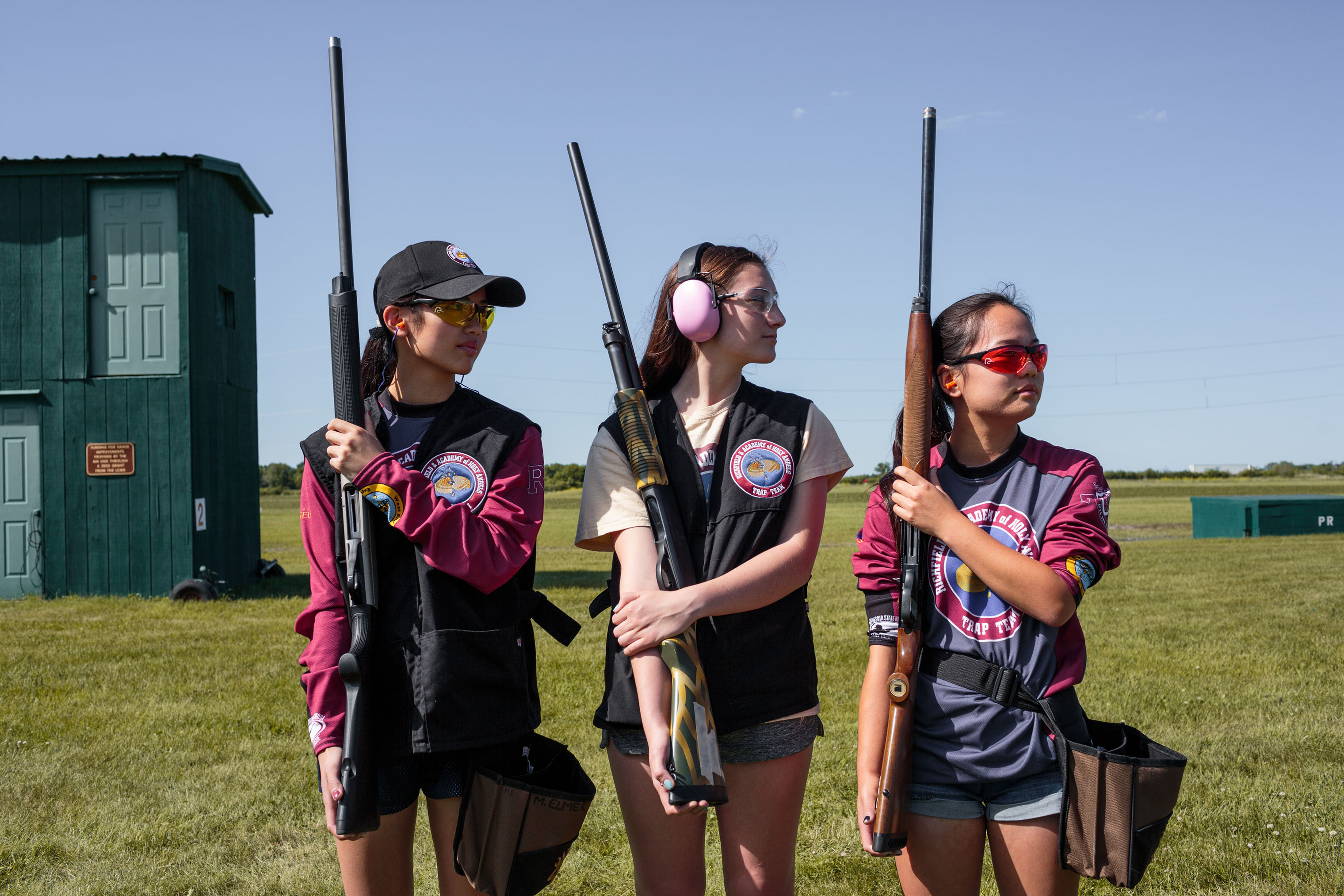 Members of the Richfield and Academy of Holy Angels Trap Team pose for a portrait before competing at the annual trap shooting championship in Alexandria, Minnesota on June 13, 2018.