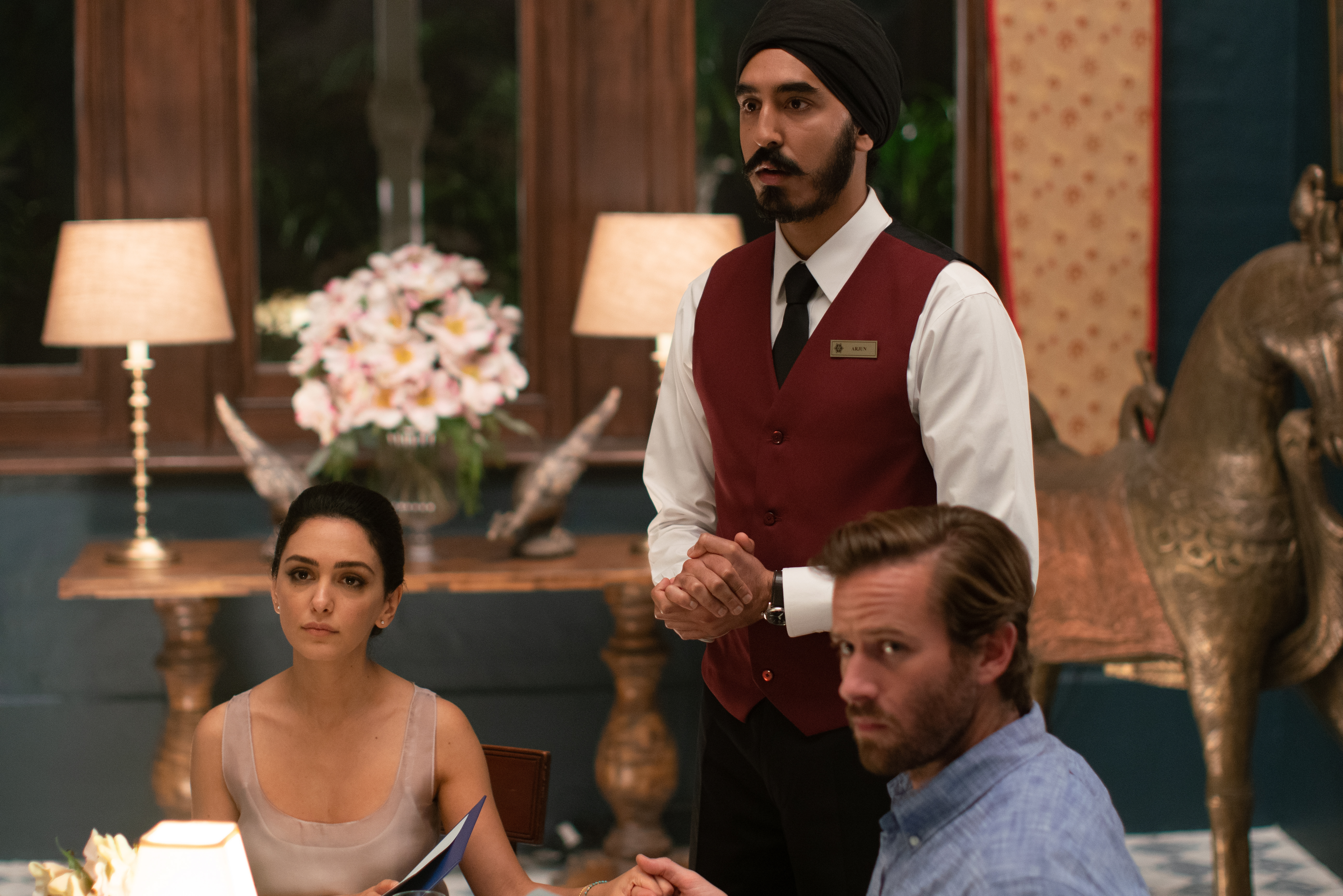 Nazanin Boniadi, Dev Patel and Armie Hammer in 'Hotel Mumbai.'
