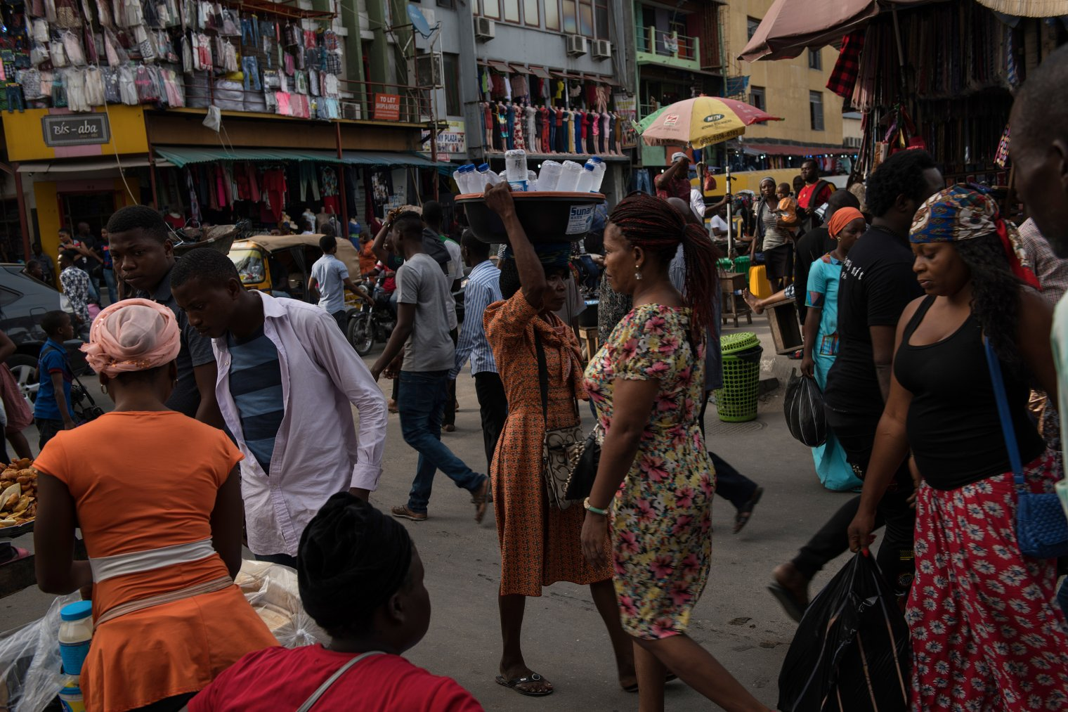 Nigerians walk through the market in Lagos, Nigeria, March 20, 2018