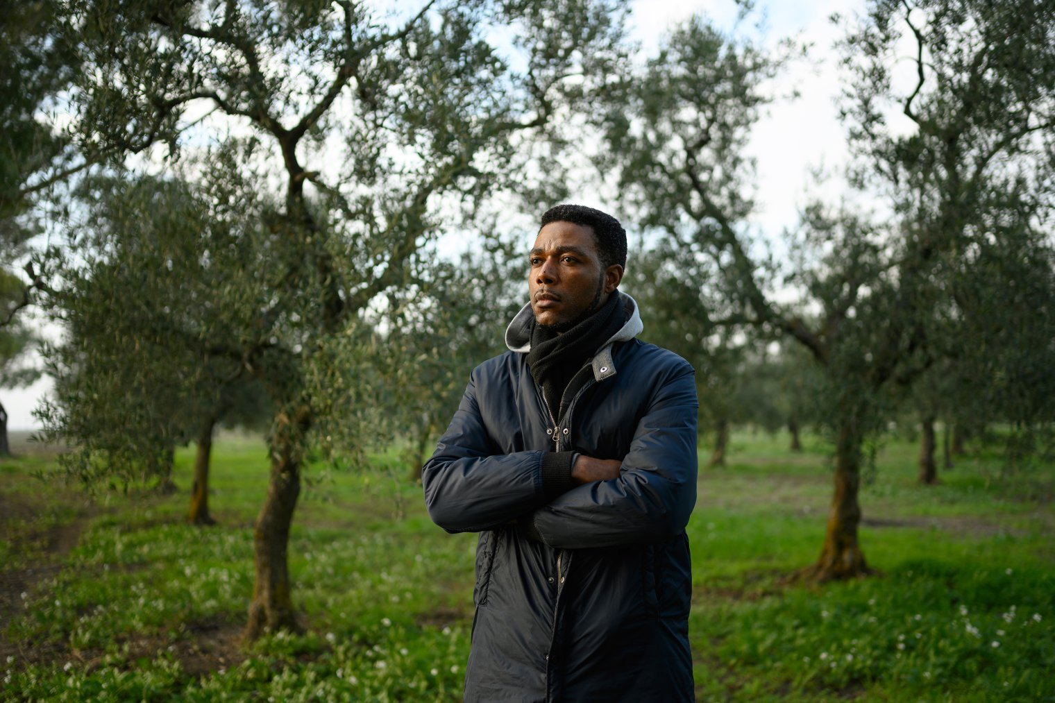 Sagnet, 33, an anti-slavery activist from Cameroon who has been living in Italy since 2010, stands in the olive groves around Foggia, Italy, Dec. 4, 2018.