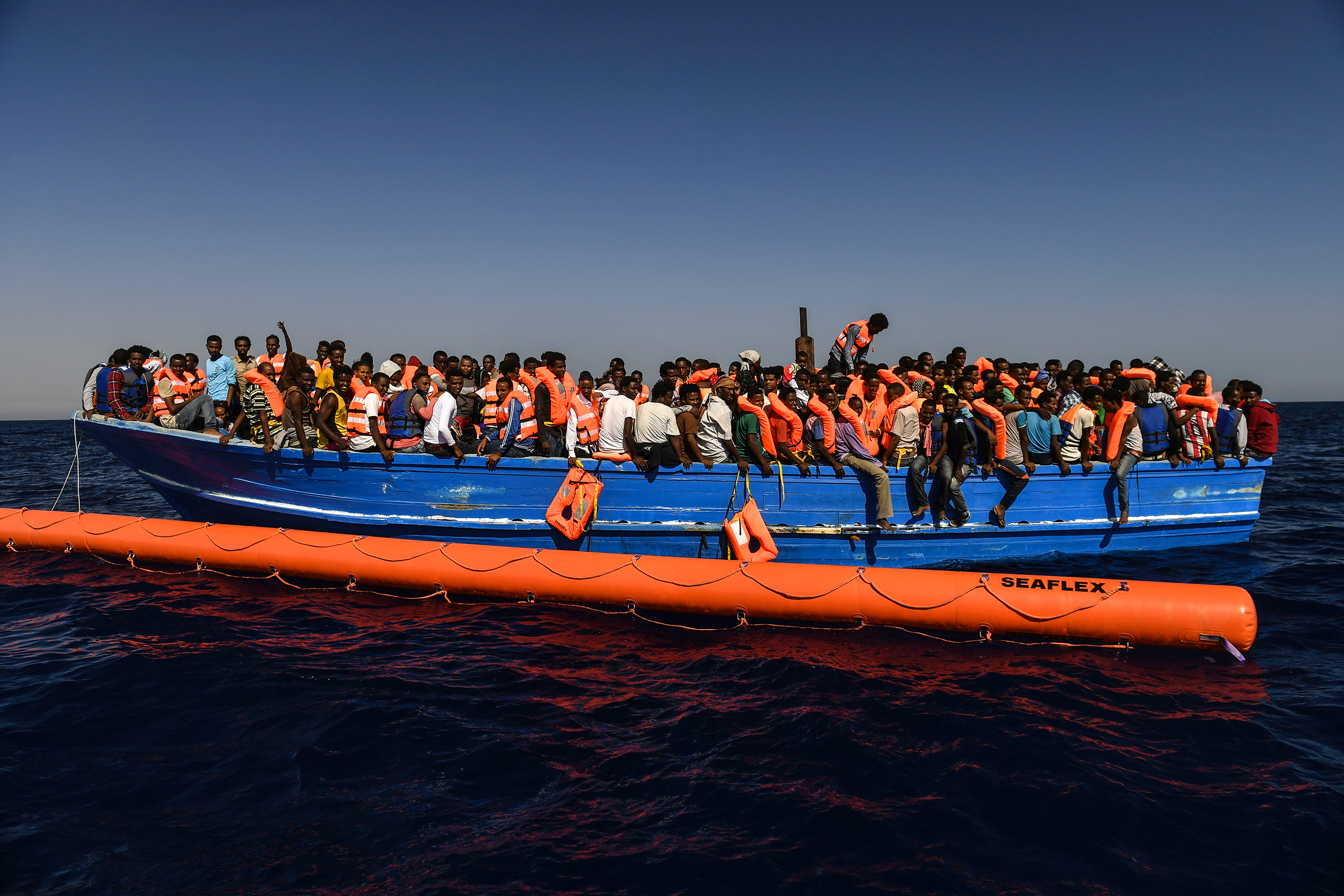 Search and rescue staff and medics, jointly run by SOS Mediterranee and Doctors Without Borders, rescue migrants in the Mediterranean Sea, about 25 miles off the coast of Libya, Aug. 20, 2016.
