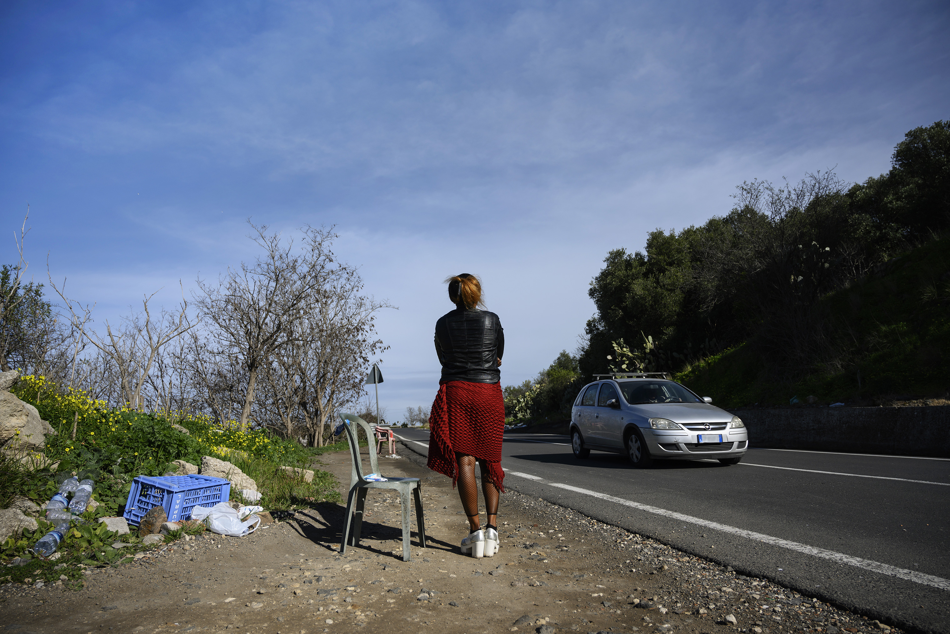 Blessing, 29, a Nigerian woman trafficked into sex work, waits for customers in Sicily, Italy