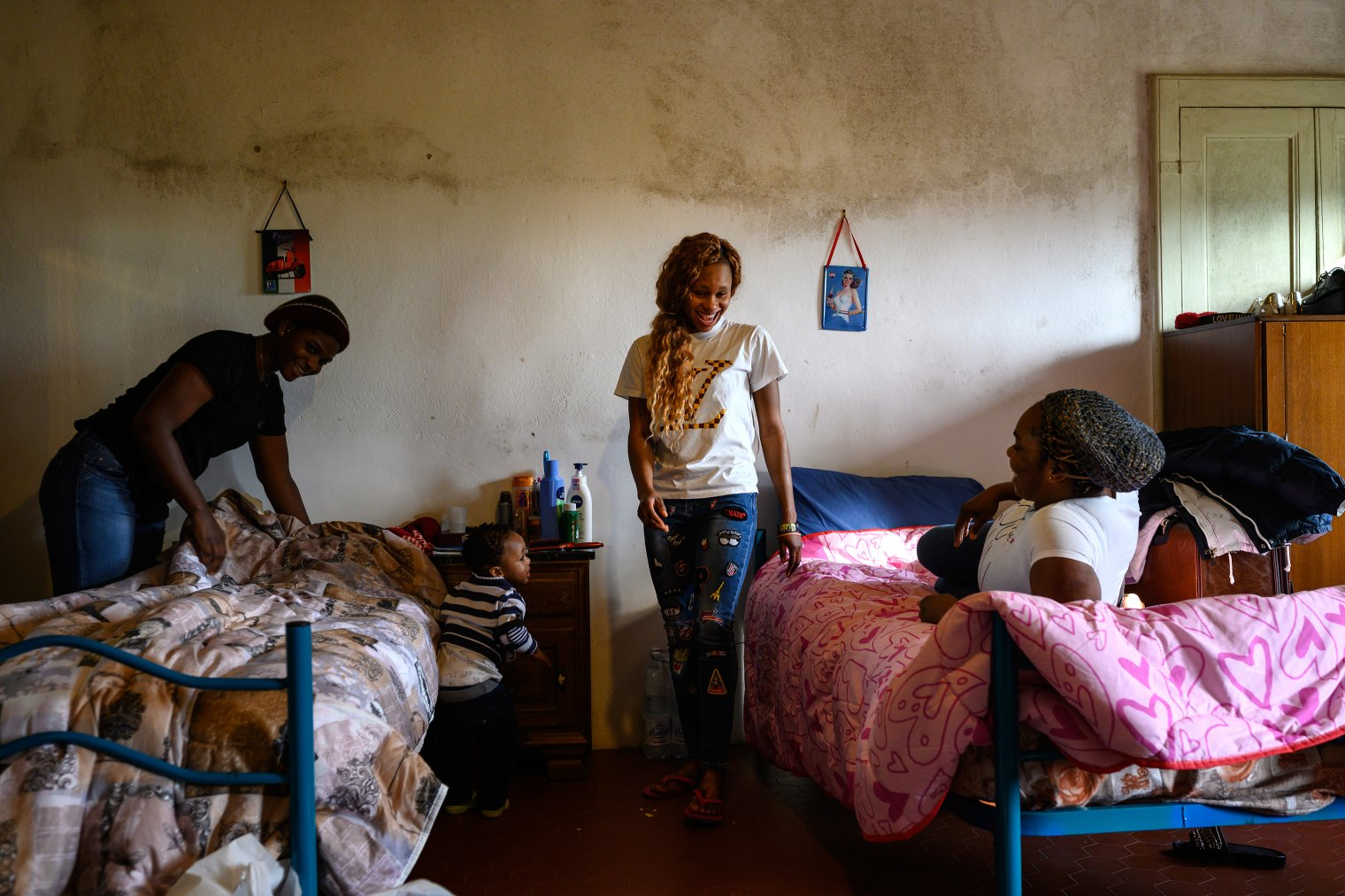 Gladys, far left, a Nigerian woman trafficked into prostitution, with other victims of trafficking in a women's shelter near Asti, Italy