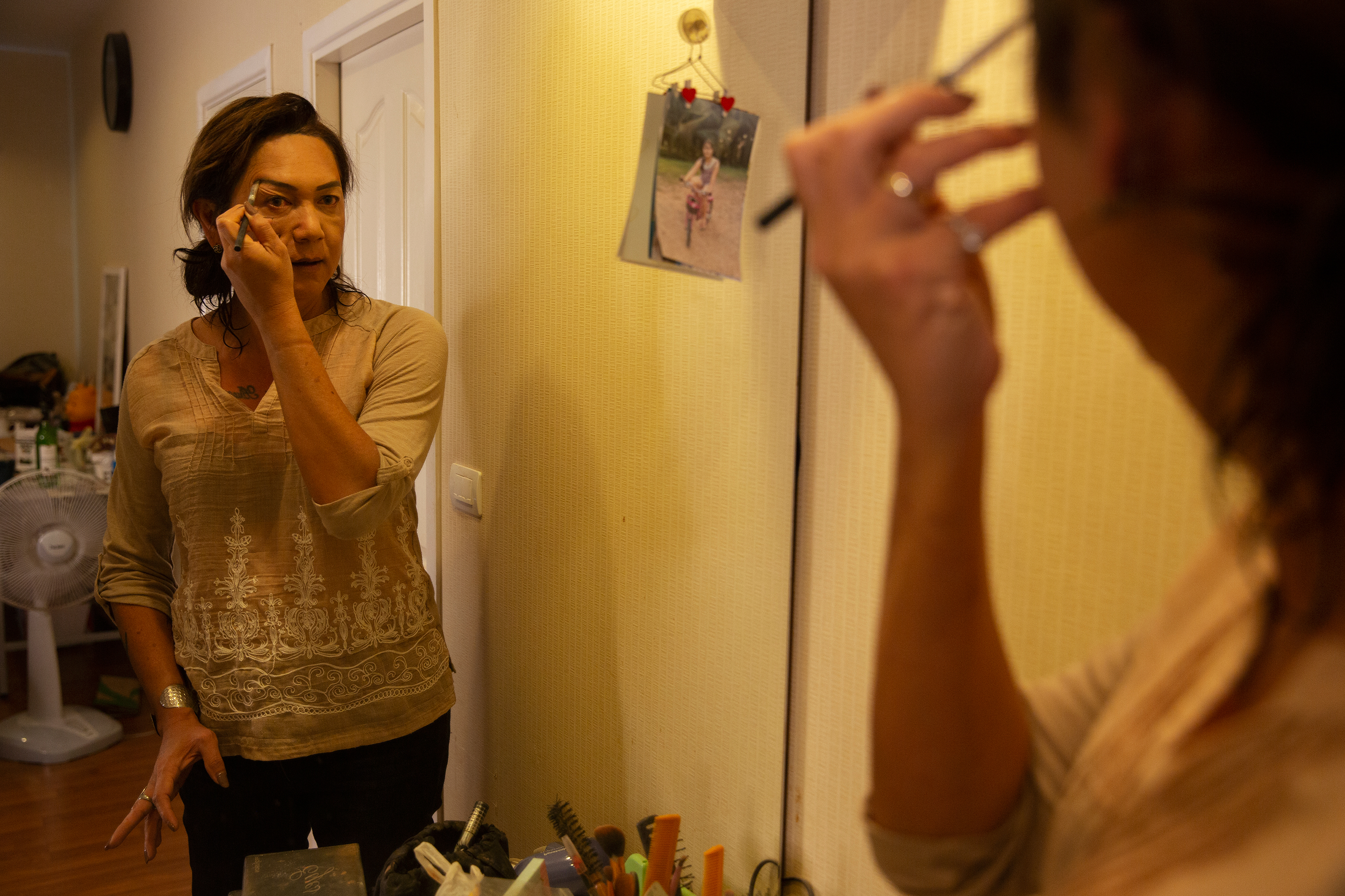 "Pauline applies makeup at her home one recent March morning.  I felt so proud as a man,"" she says, ""but when I went home, the feeling of becoming a woman came back again — it never went away."""