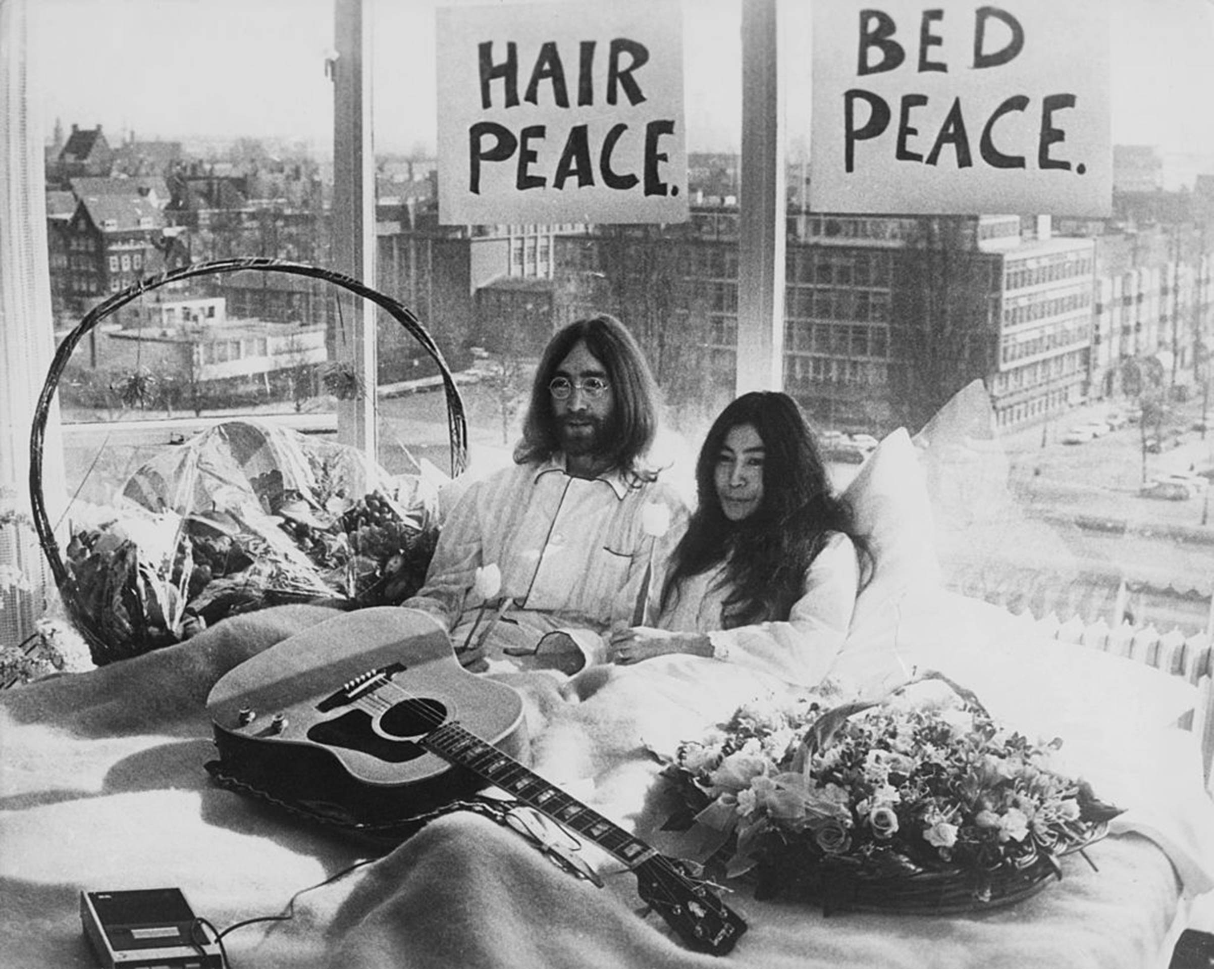 Newly-weds John Lennon of The Beatles and artist Yoko Ono kick-off a bed-in for peace on Mar. 25, 1969, in their suite at the Hilton Amsterdam in The Netherlands.