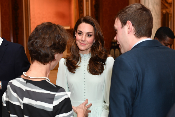 Catherine, Duchess of Cambridge speaks to guests as she attends a reception to mark the fiftieth anniversary of the investiture of the Prince of Wales at Buckingham Palace in London on March 5, 2019.