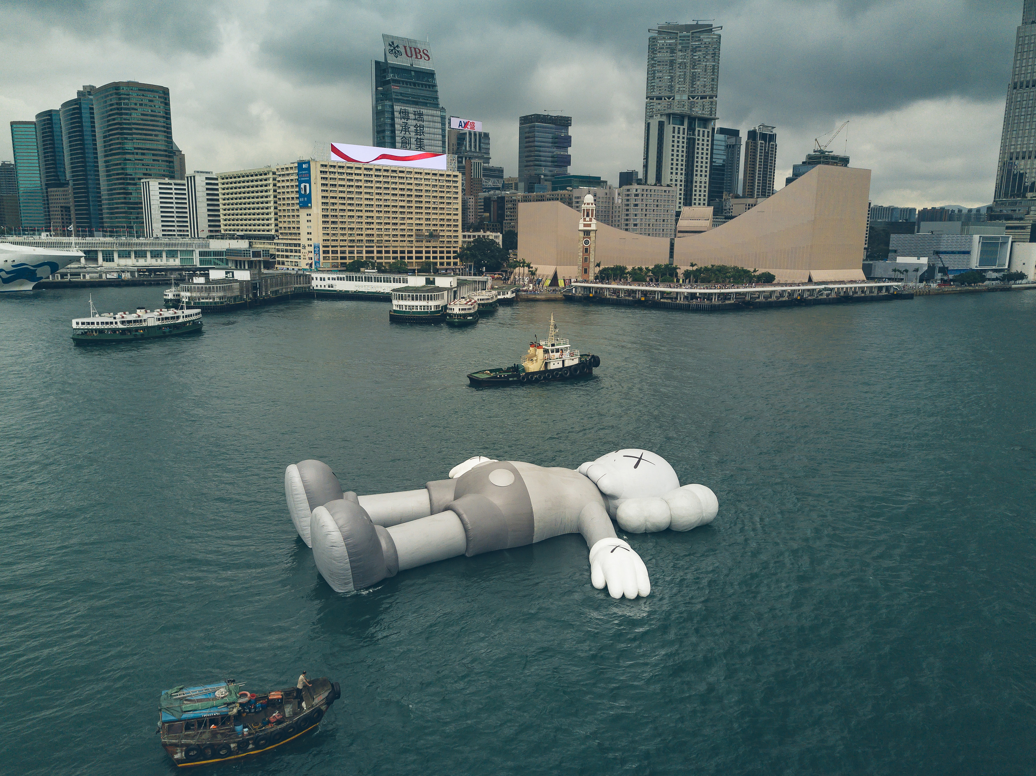 KAWS' sculpture 'Companion' floats in Victoria Harbor in Hong Kong on March 22, 2019.