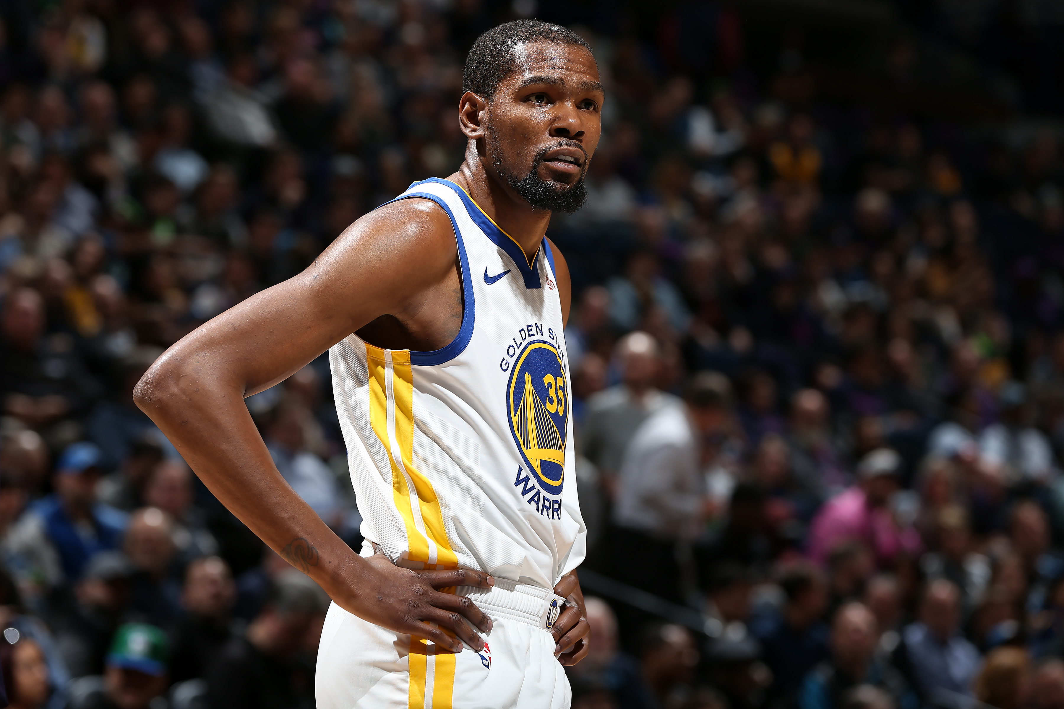 MINNEAPOLIS, MN - MARCH 19: Kevin Durant #35 of the Golden State Warriors looks on against the Minnesota Timberwolves on March 19, 2019 at Target Center in Minneapolis, Minnesota. NOTE TO USER: User expressly acknowledges and agrees that, by downloading and or using this Photograph, user is consenting to the terms and conditions of the Getty Images License Agreement. Mandatory Copyright Notice: Copyright 2019 NBAE (Photo by David Sherman/NBAE via Getty Images)