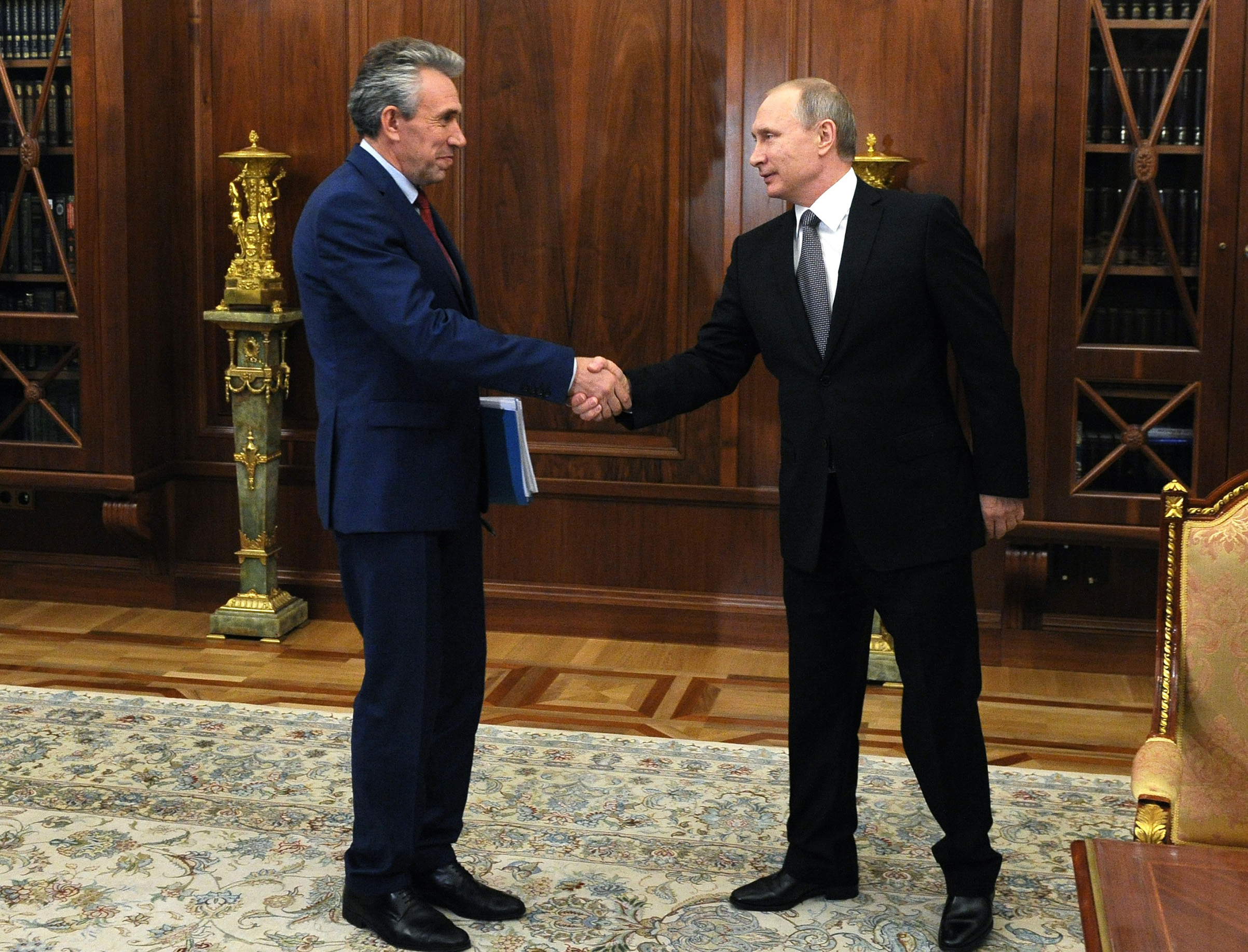 Then-Chairman of Russia's Vnesheconombank, Sergey Gorkov, left, meets Russian President Vladimir Putin at the Kremlin on Aug. 3, 2016.