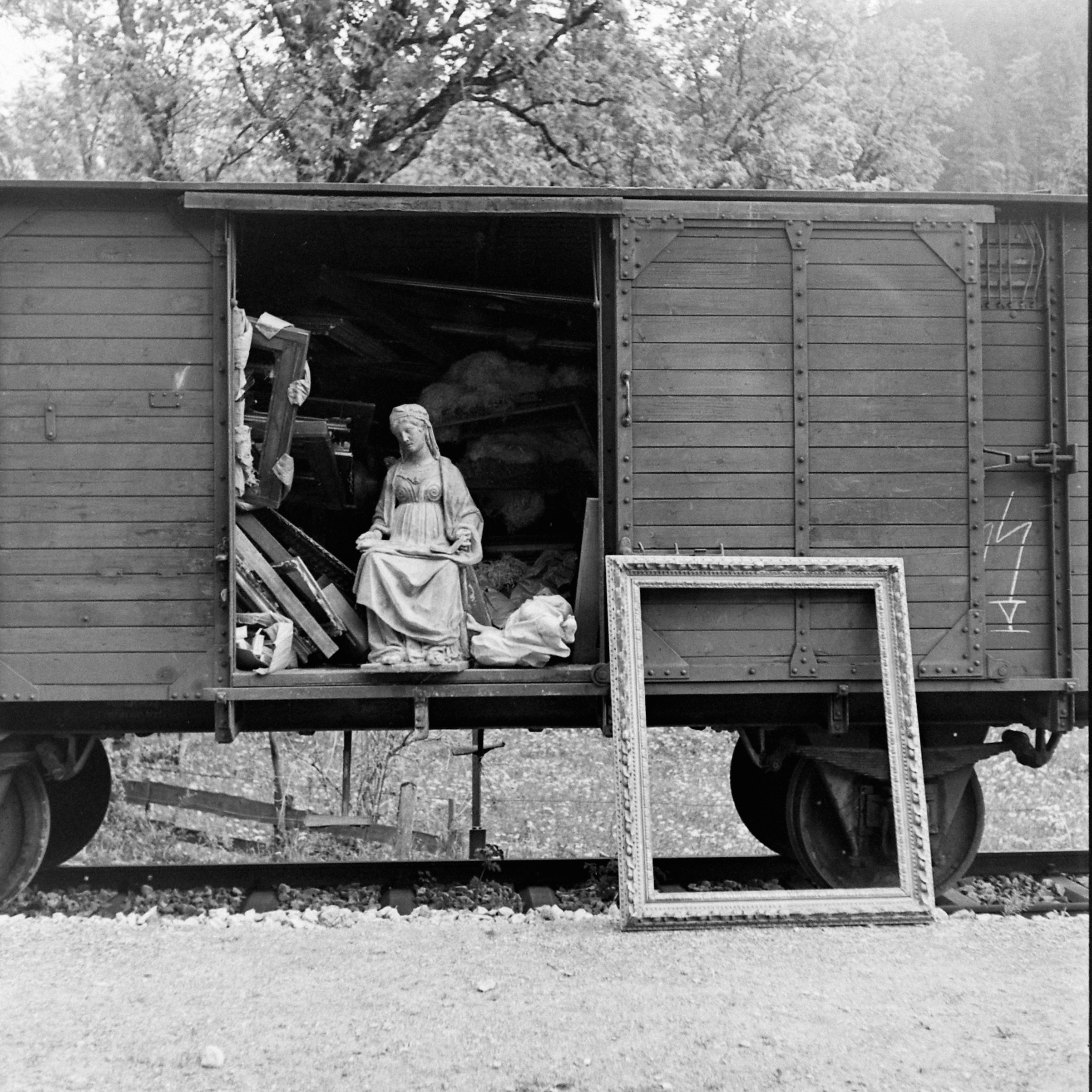 View of a train boxcar, through the open door of which can be seen some of the art collection looted by the Nazis, near Berchtesgaden, Germany, 1945.