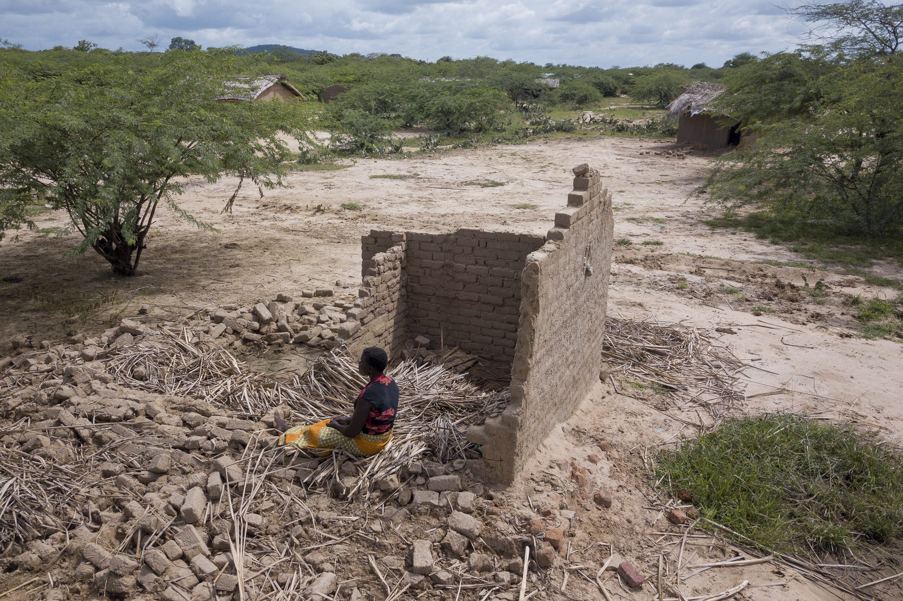 Eliza Jasi has experienced three floods: 2012, 2015, 2019. She has been able to rebuild her home using old bricks after each flood. This time around she will not be able to.