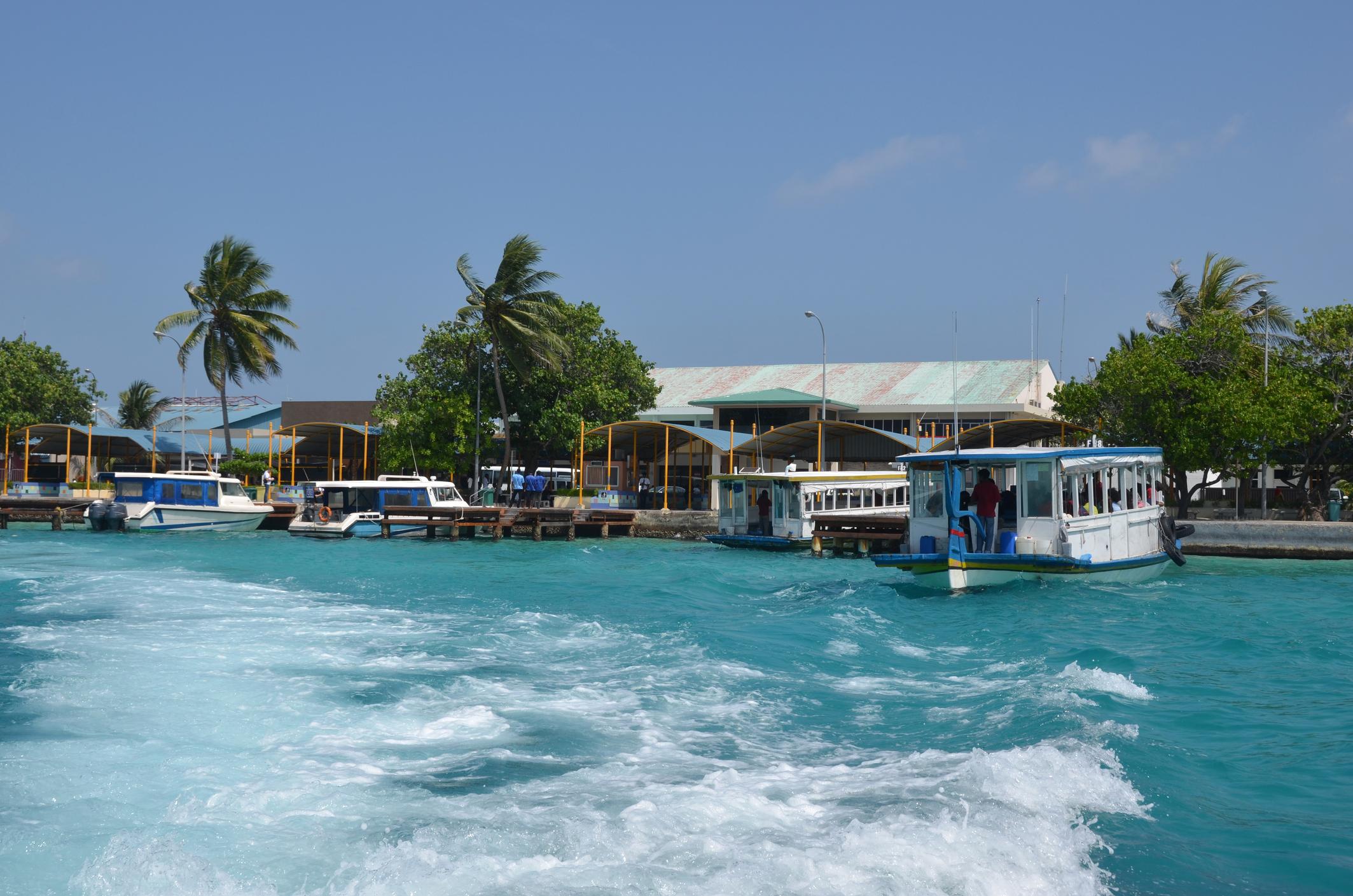 Dhonis (traditional Maldivian boats) at the Velana International Airport.