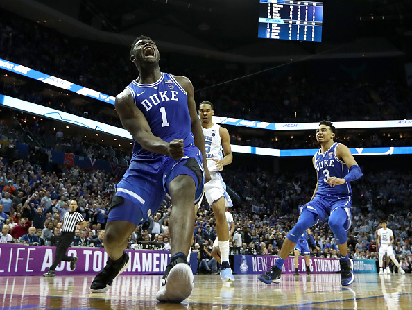 Zion Williamson #1 of the Duke Blue Devils reacts after a dunk against the North Carolina Tar Heels during their game in the semifinals of the 2019 Men's ACC Basketball Tournament at Spectrum Center in Charlotte, North Carolina on March 15, 2019.