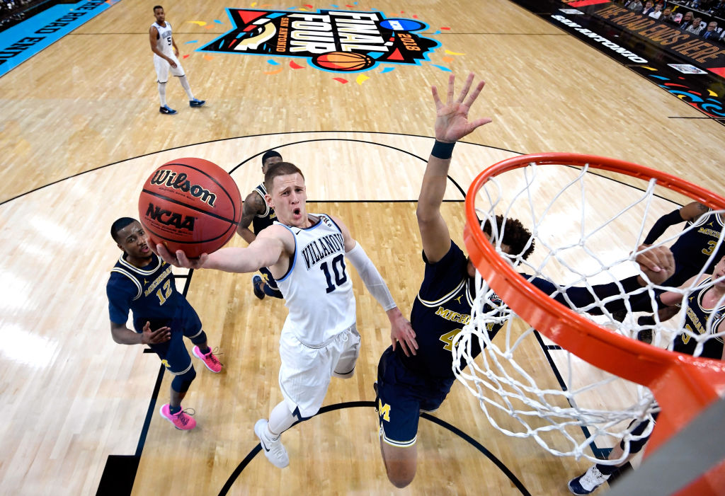 Donte DiVincenzo #10 of the Villanova Wildcats drives to the basket against Isaiah Livers #4 of the Michigan Wolverines in the first half during the 2018 NCAA Men's Final Four National Championship game at the Alamodome on April 2, 2018 in San Antonio, Texas.