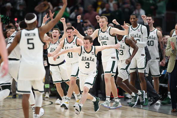 Michigan State Spartans guard Foster Loyer #3 and Michigan State Spartans players celebrate after defeating the Michigan Wolverines in a Big Ten Tournament Championship game between the Michigan Wolverines and the Michigan State Spartans at the United Center in Chicago, IL on March 17, 2019.