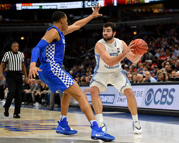 North Carolina Tar Heels forward Luke Maye #32 handles the ball against Kentucky Wildcats forward PJ Washington #25 during the CBS Sports Classic at the United Center in Chicago, Illinois on December 22, 2018.