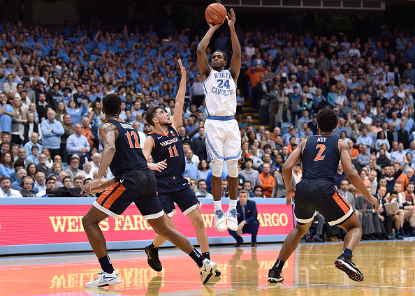Kenny Williams #24 of the North Carolina Tar Heels takes a three-point shot against the Virginia Cavaliers during their game at the Dean Smith Center in Chapel Hill, North Carolina on February 11, 2019 .