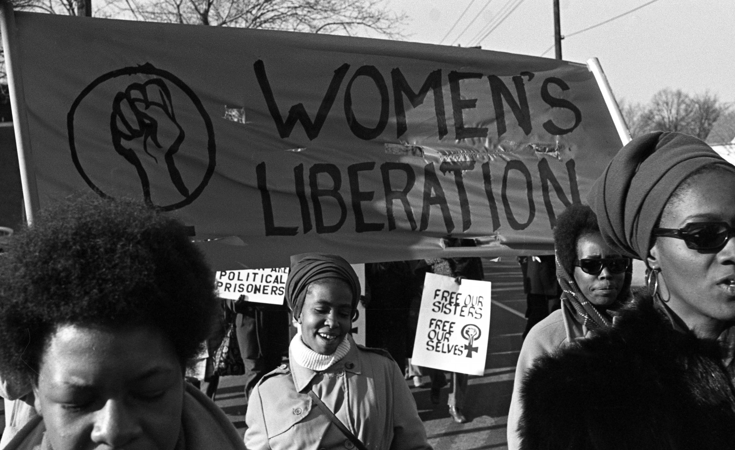 A group of women, under a 'Women's Liberation' banner, march in support of the Black Panther Party, New Haven, Conn., November 1969