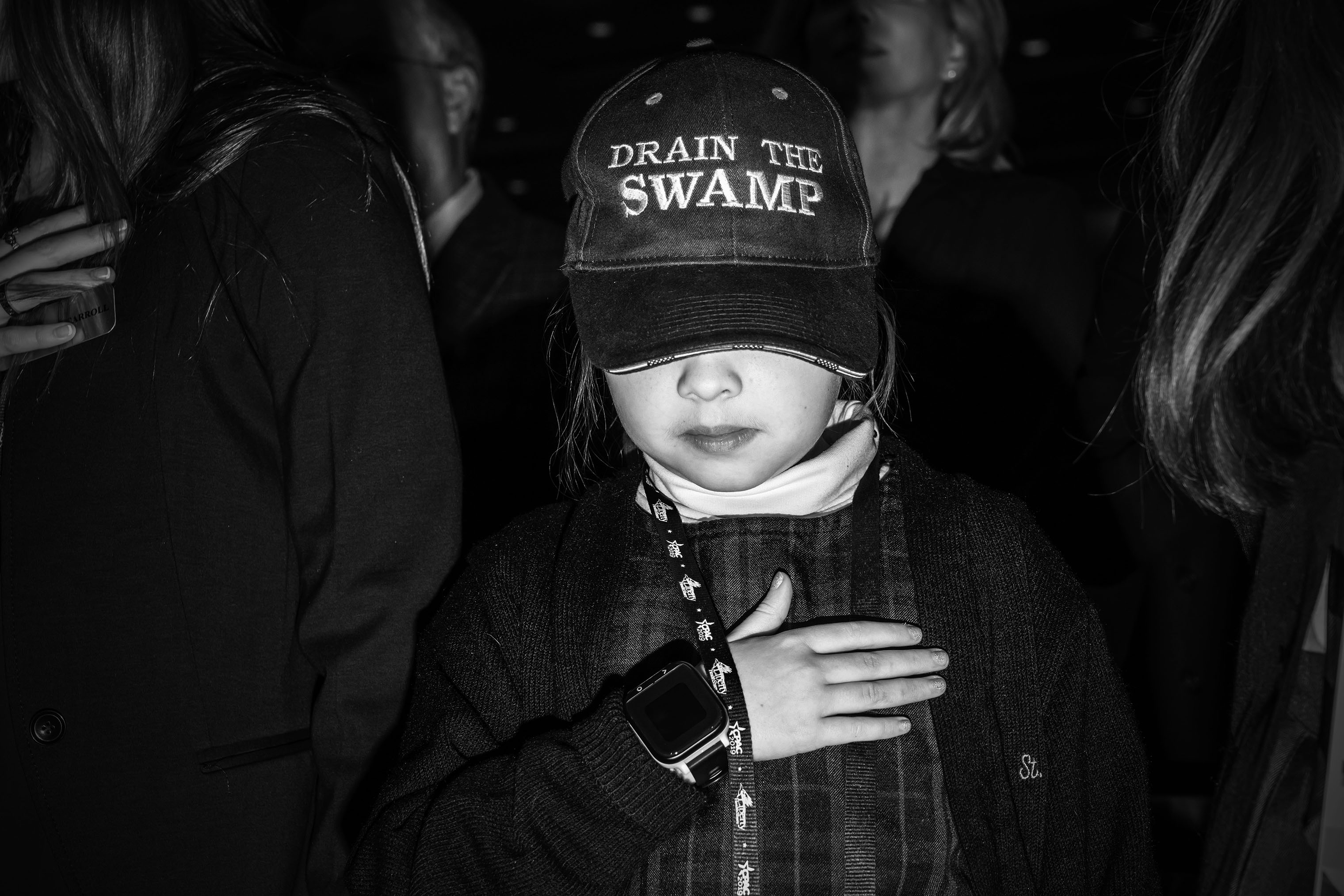 A young attendee shows support for President Donald Trump.