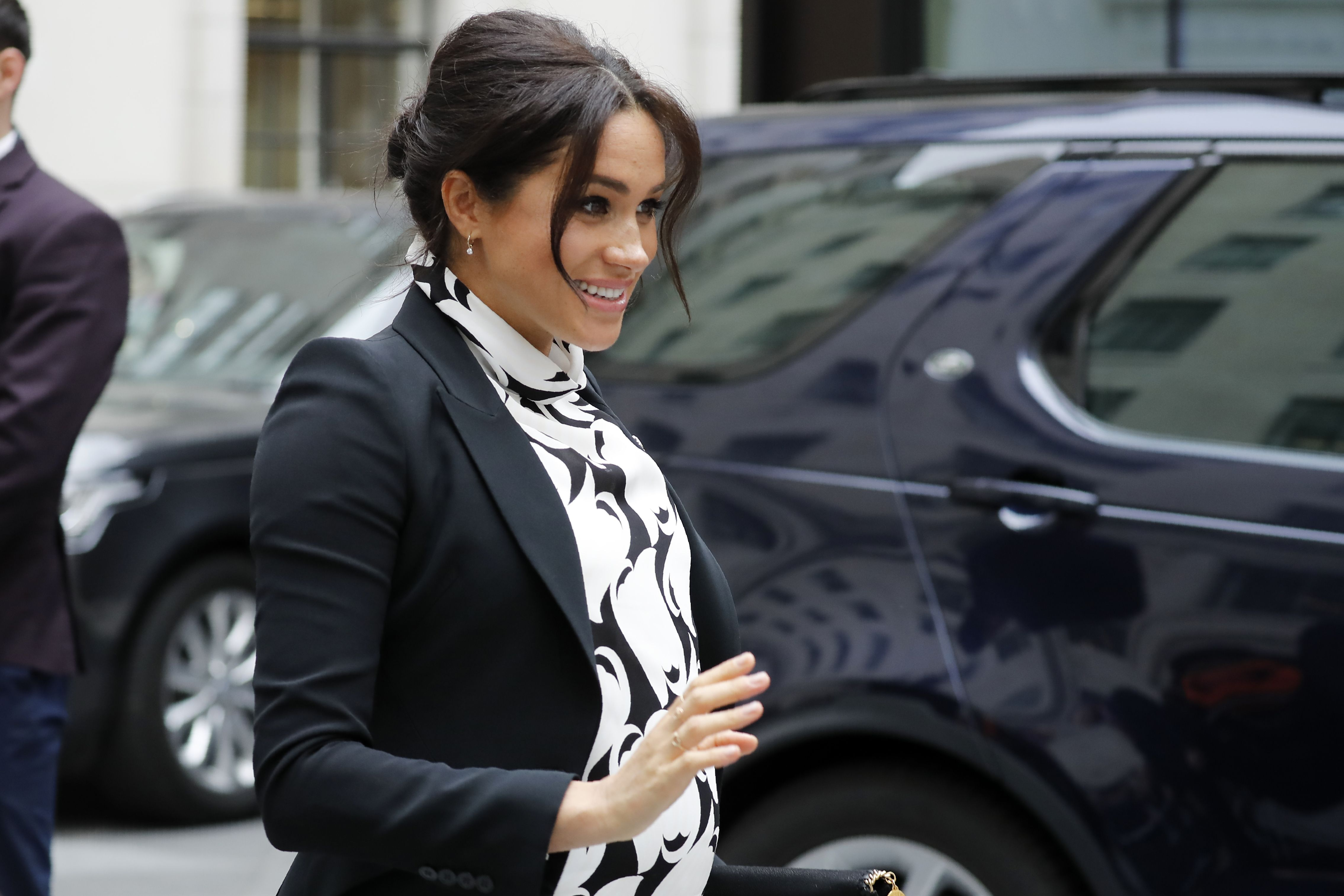 Britain's Meghan, Duchess of Sussex leaves after participating in a panel discussion convened by the Queen's Commonwealth Trust to mark International Women's Day in London on March 8, 2019.