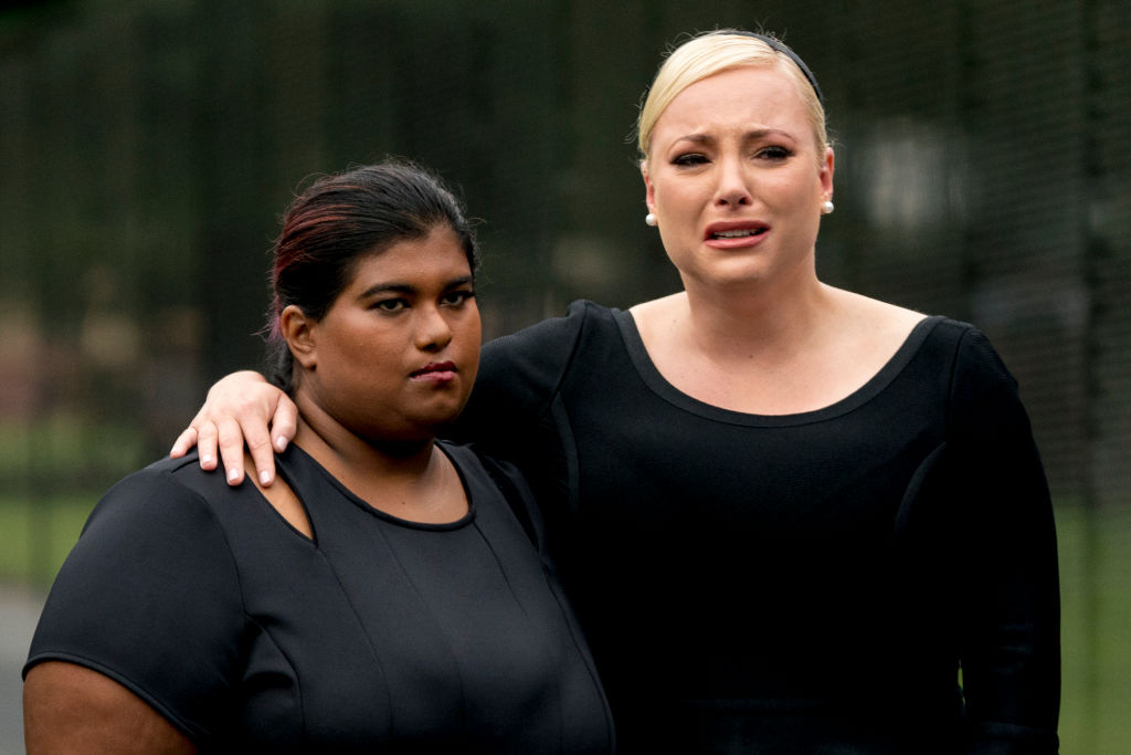 Bridget McCain and Meghan McCain, daughters of, Sen. John McCain, R-Ariz., watch as Cindy McCain lays a wreath at the Vietnam Veterans Memorial during a funeral procession to carry the casket of her husband from the U.S. Capitol to National Cathedral for a Memorial Service on September 1, 2018 in Washington, D.C.
