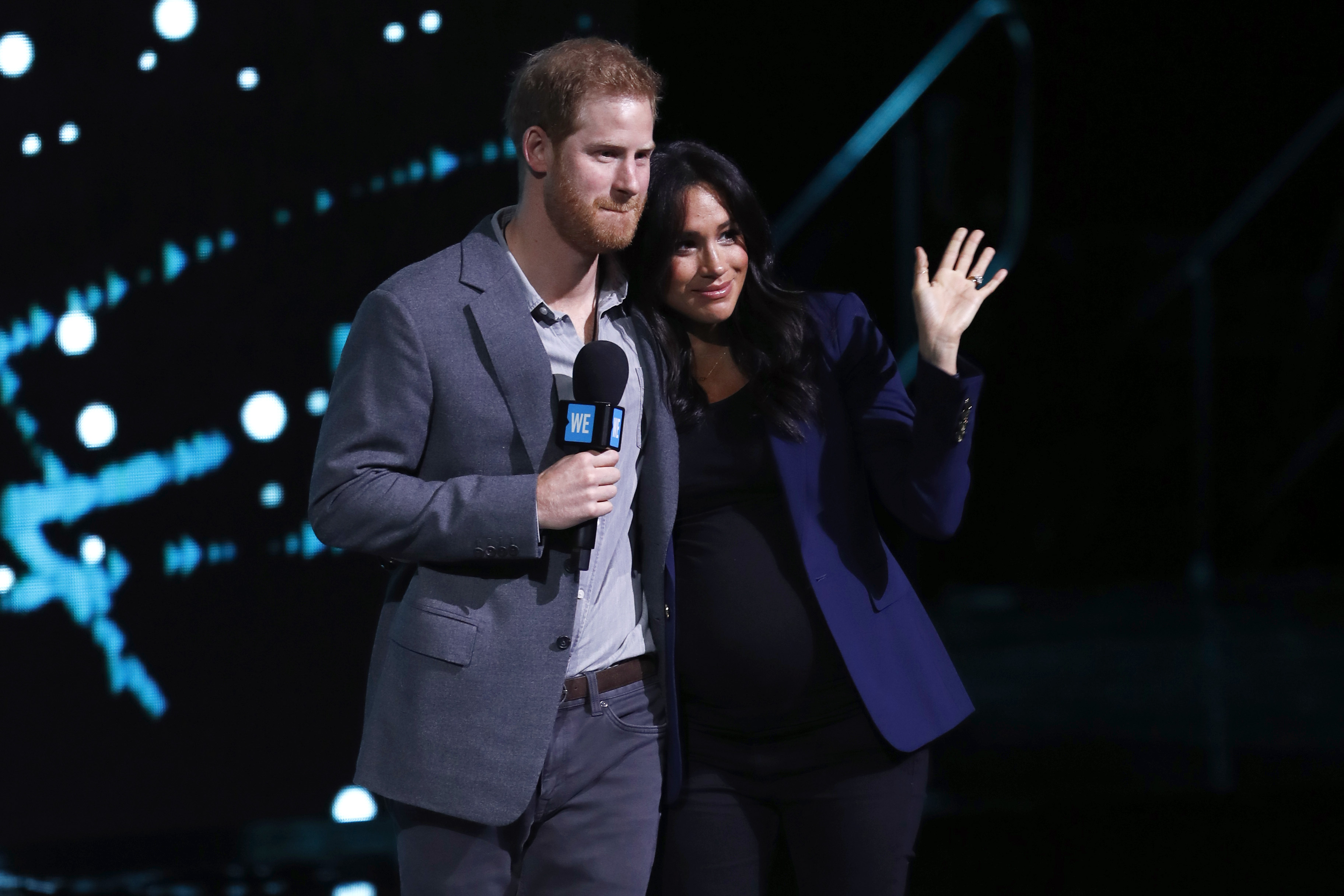 Meghan, Duchess of Sussex joins Prince Harry, Duke of Sussex and speak on stage during WE Day UK 2019 at The SSE Arena in London. (Photo by John Phillips/Getty Images)