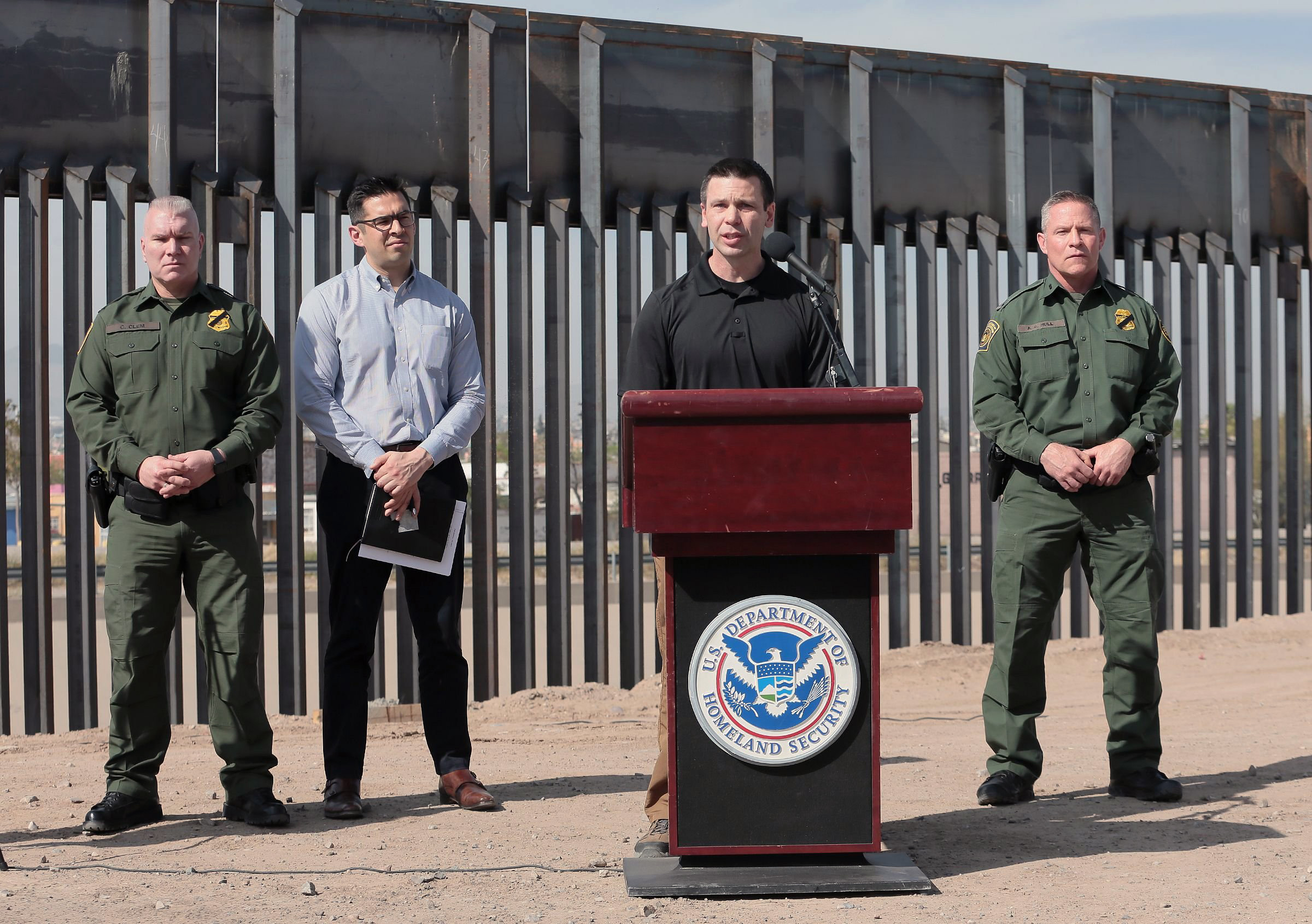 U.S. Customs and Border Protection Commissioner Kevin K. McAleenan, with the bollard border fence in the background, held a press conference in El Paso, Texas, on Mar. 27, 2019. McAleenan said the border has hit its  breaking point  due to flood of migrants in what he described as  a system that is broken and overwhelmed.