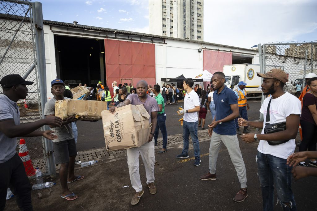 Humanitarian aid is carried to the docks in Maputo, Mozambique in the wake of Cyclone Idai on March 22, 2019.