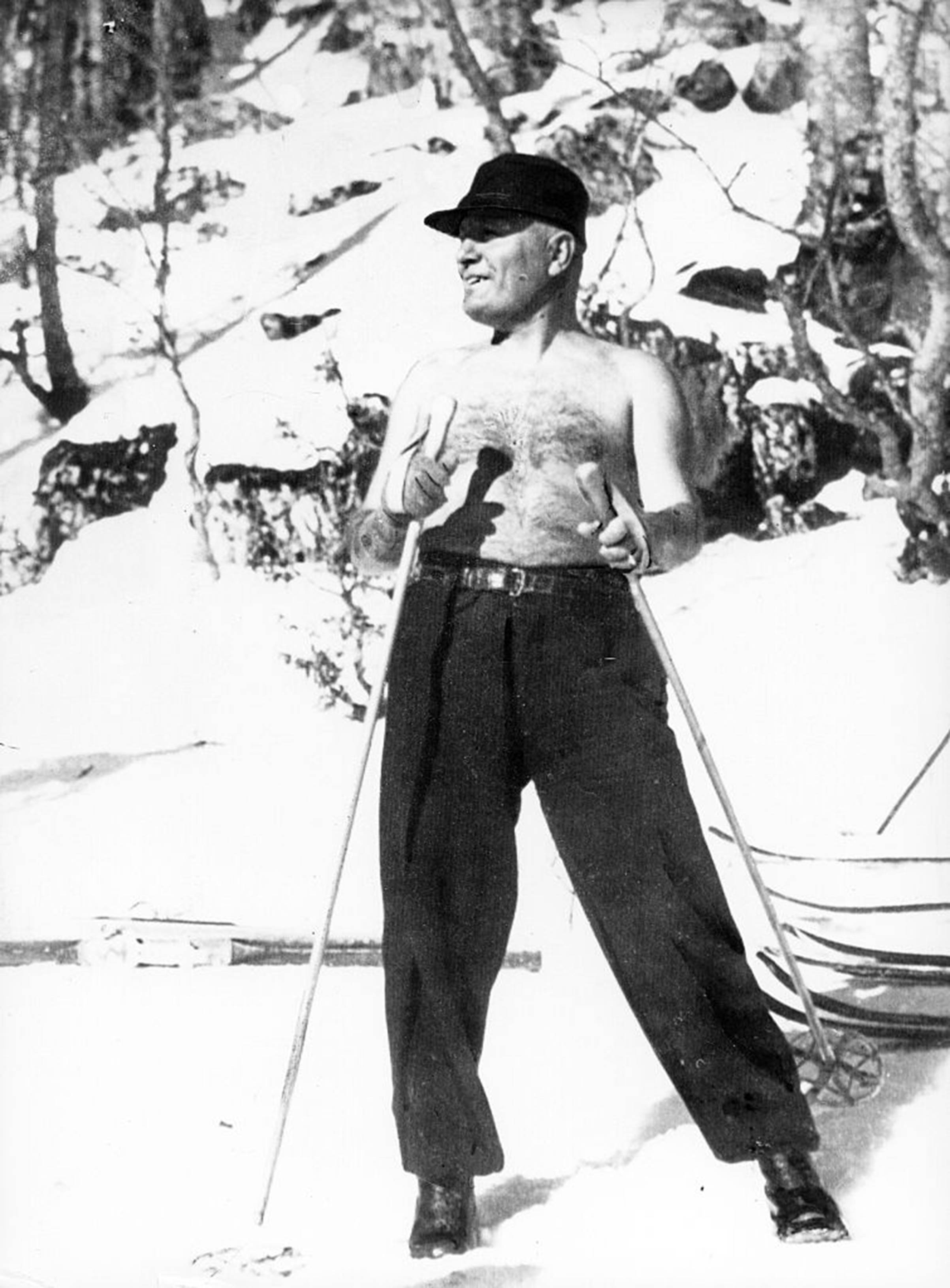 Italian fascist dictator Benito Mussolini strikes a pose while skiing in Italy with his son in 1937.