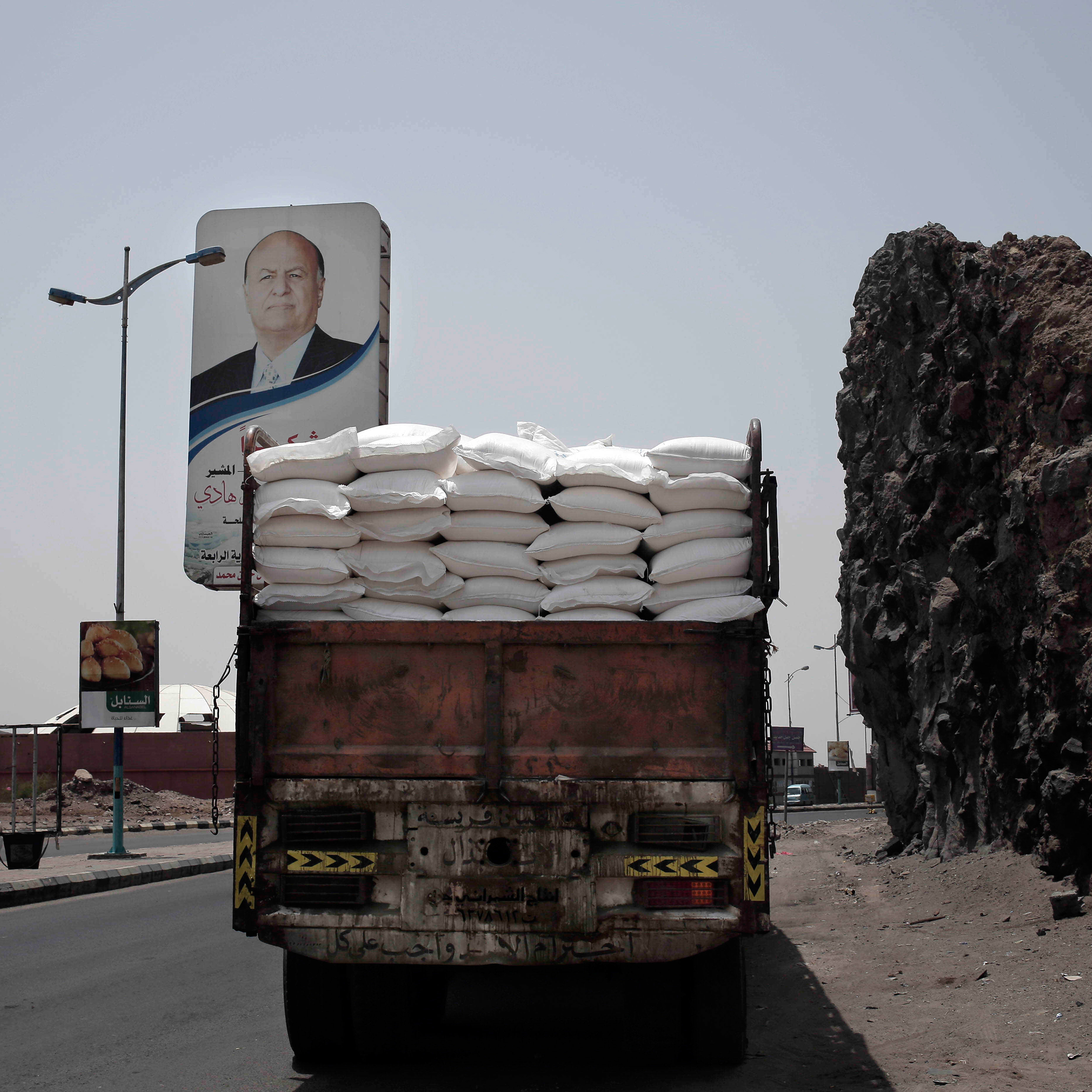 A truck carries aid on a road in Aden on July 23.