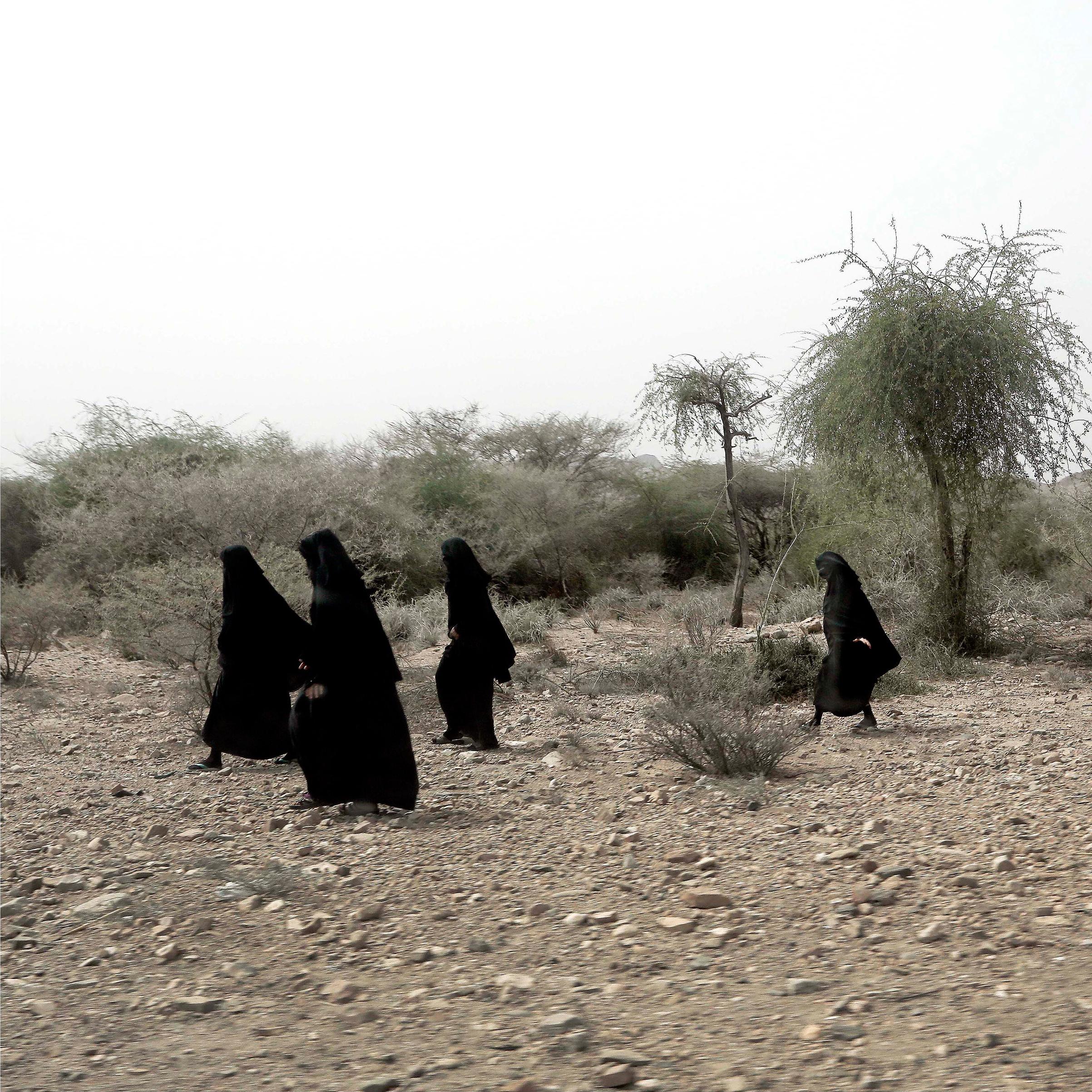 A group of women walk through Shabwa on July 24.